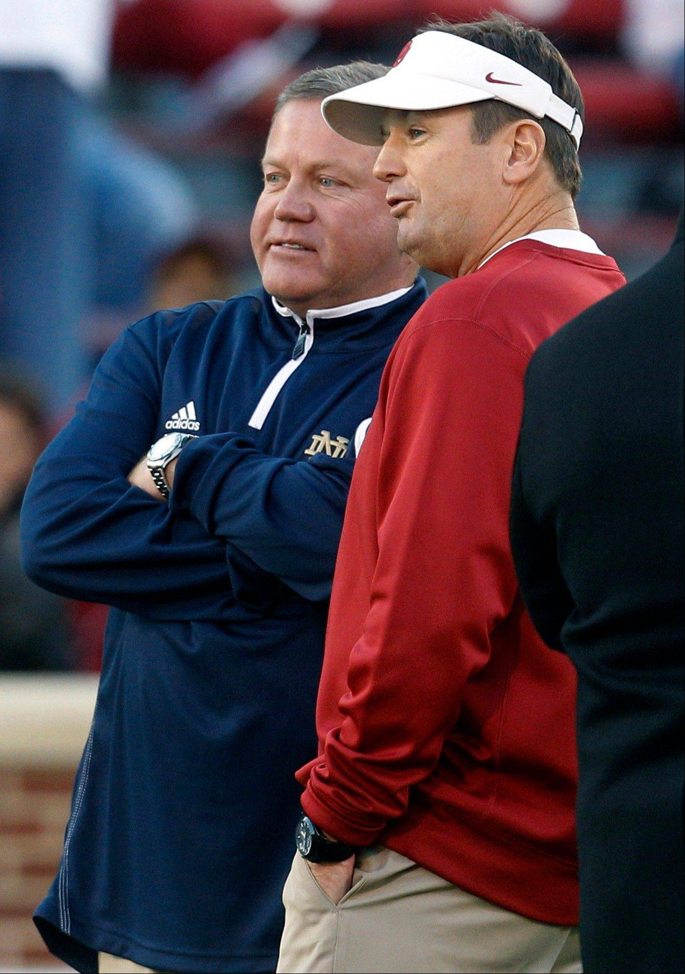 National writer John Feinstein says Notre Dame head coach Brian Kelly's team is for real, while Oklahoma head coach Bob Stoops continues to struggle against ranked teams.
