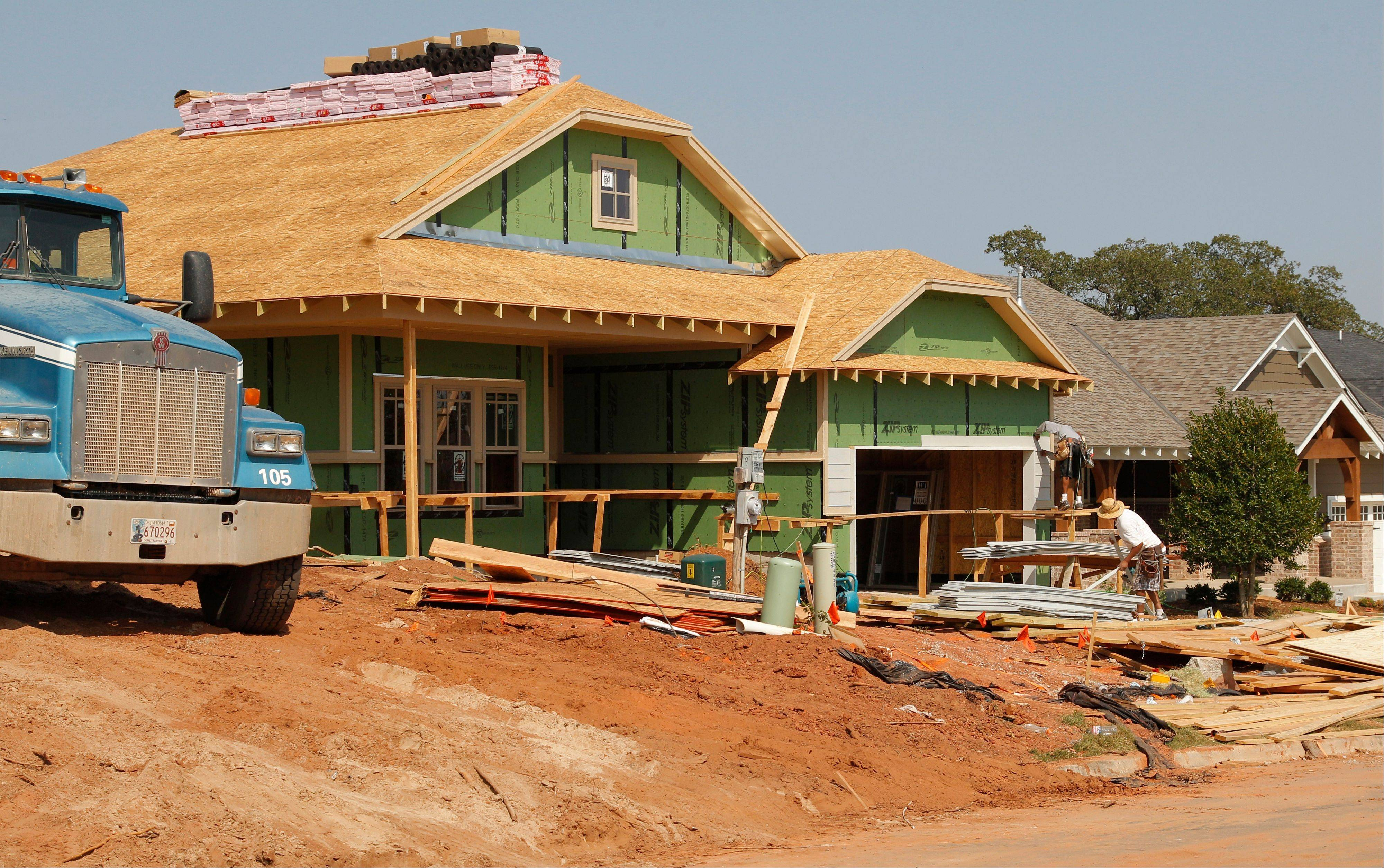 A new home is seen under construction in Edmond, Okla. U.S. sales of new homes jumped in September to the highest level in more than two years, further evidence of a sustained housing recovery that could help lift the lackluster economy.