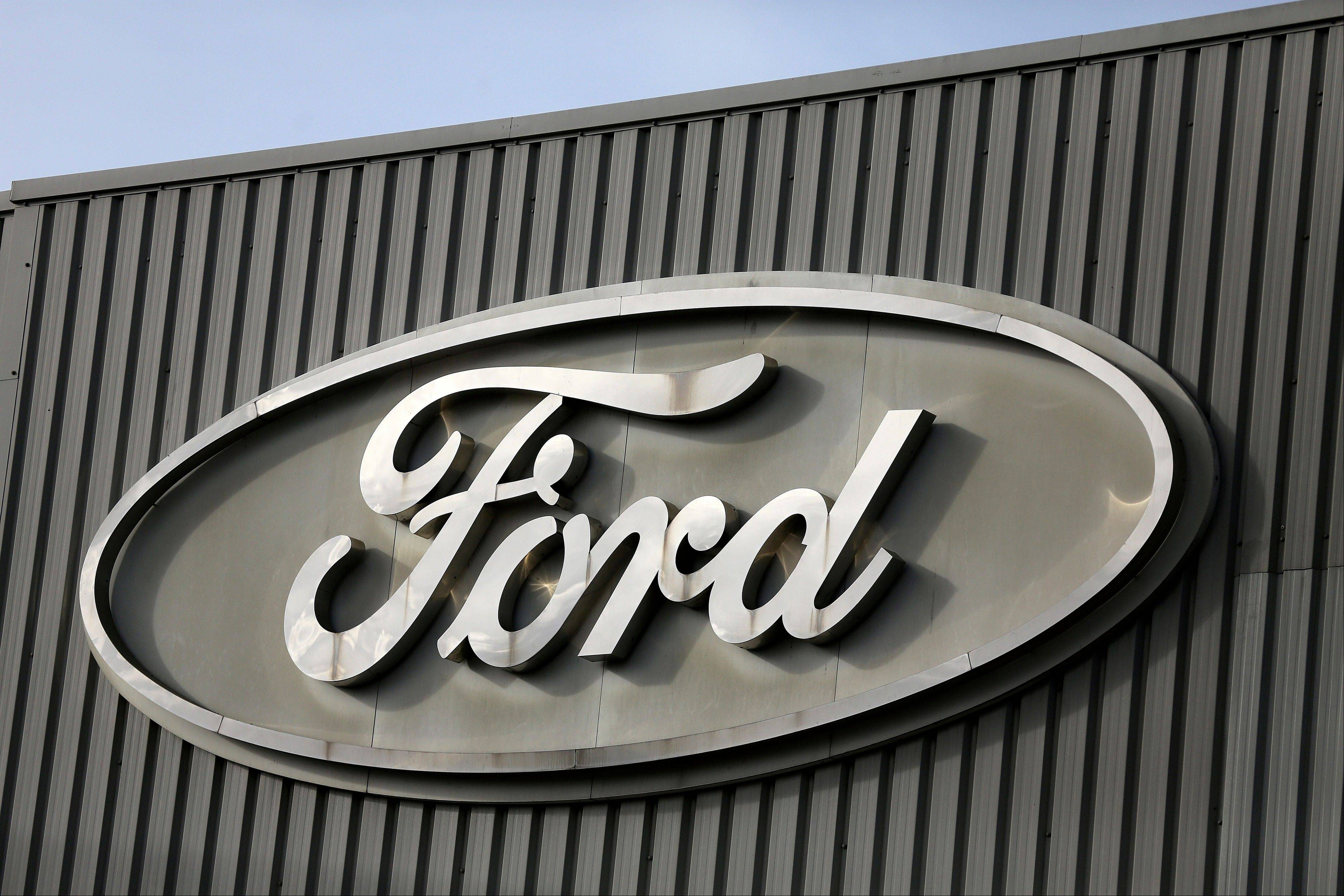 Ford Motor Co. says its net income dropped 1 percent to $1.63 billion in the third quarter as European losses swamped record North American profits.