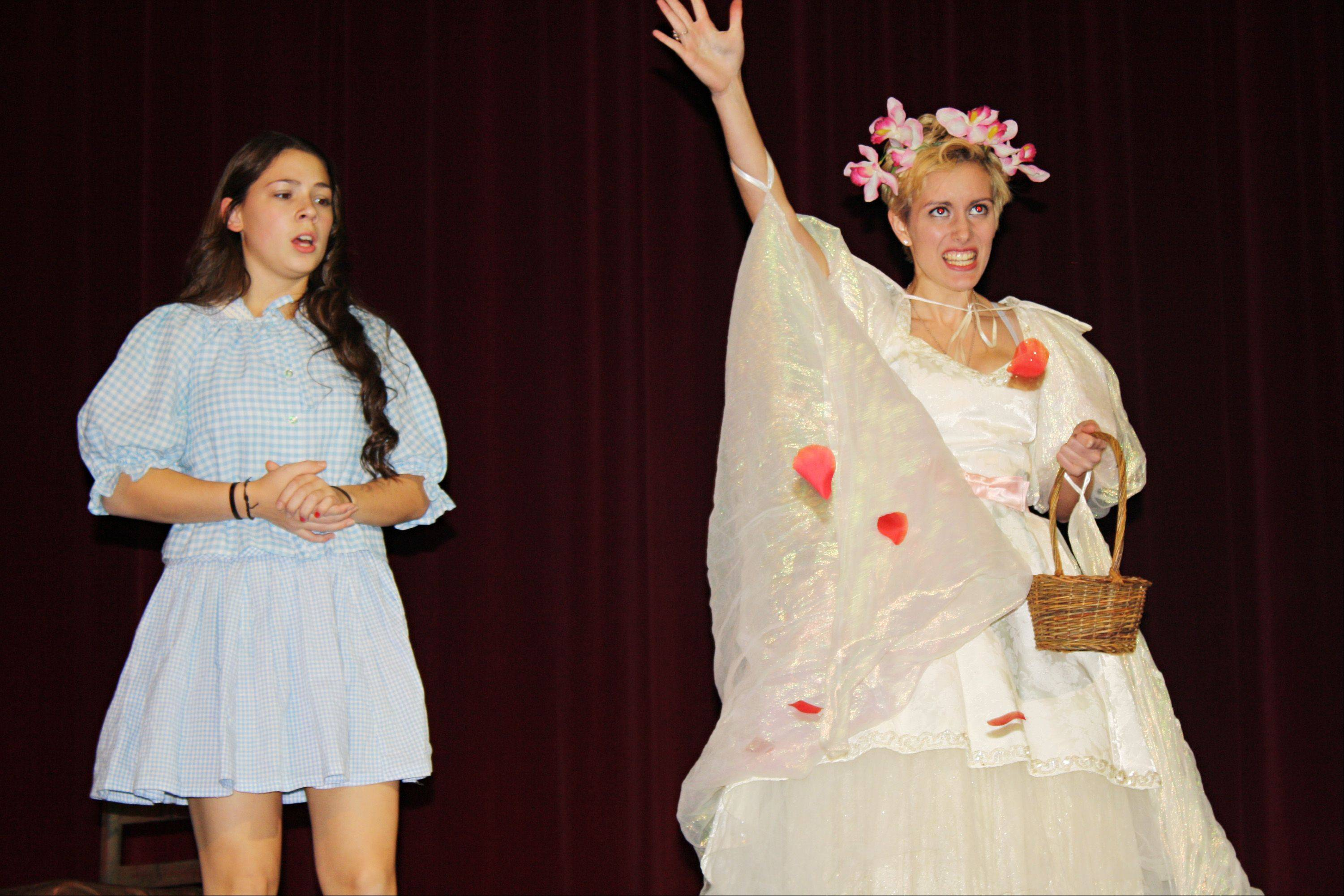"Beth, played by Eva Sarnelli meets Glinda the Good Witch, played by Jacque Miller, during a rehearsal of ""Oz"" at St. Charles North High School."