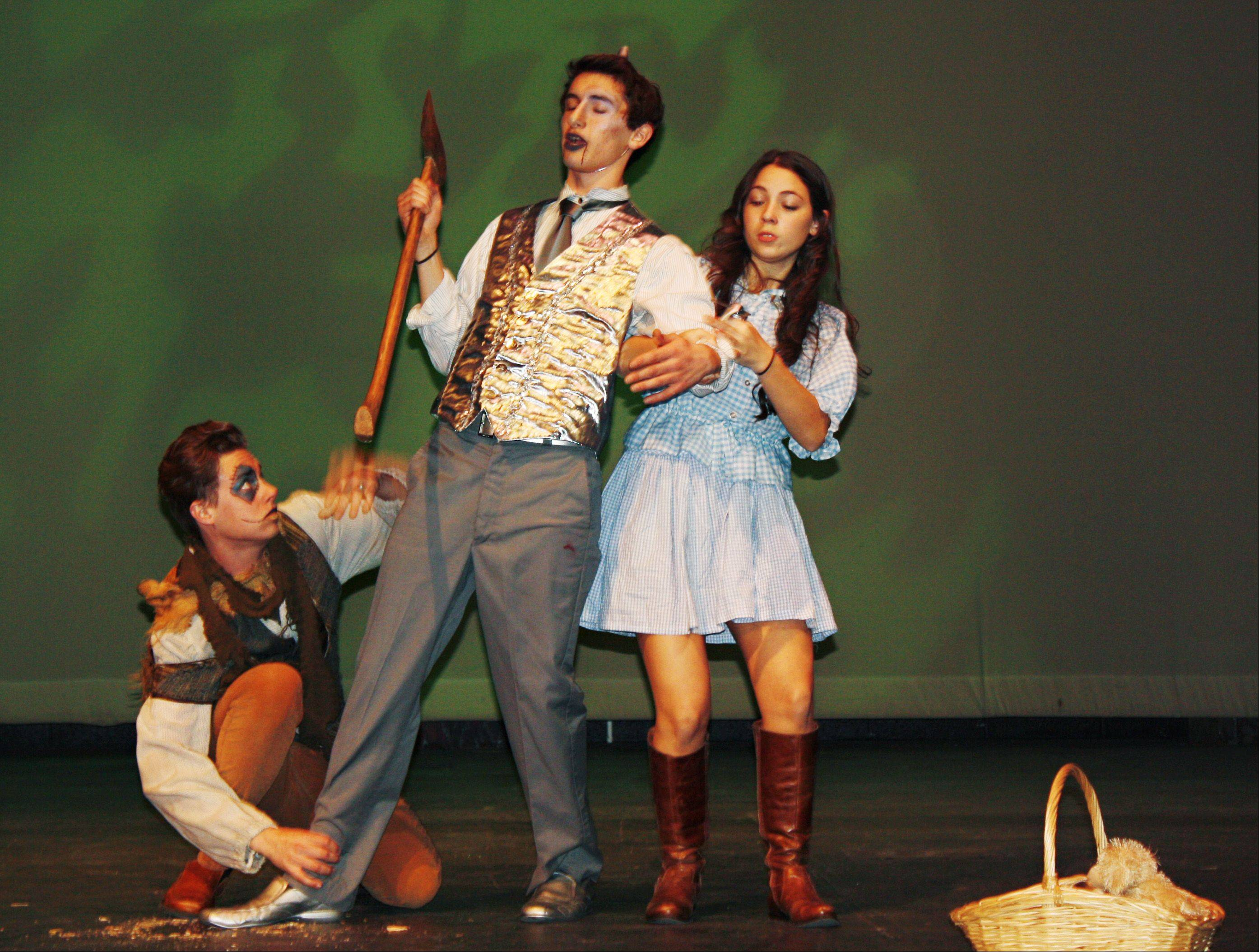 "Beth and Scarecrow try to get Tin Man moving during a recent rehearsal of ""Oz"" at St. Charles North High School. The roles are played by Eva Sarnelli, Connor Speck and Thomas Bravos, respectively."