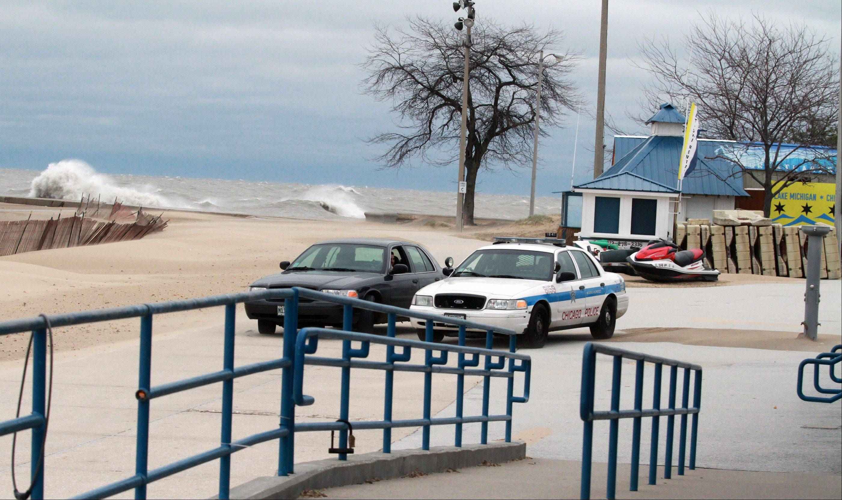 Chicago Police were keeping photographers from going to close to Lake Michigan as waves battle the shoreline at North Avenue Beach in Chicago on Tuesday, October 30.