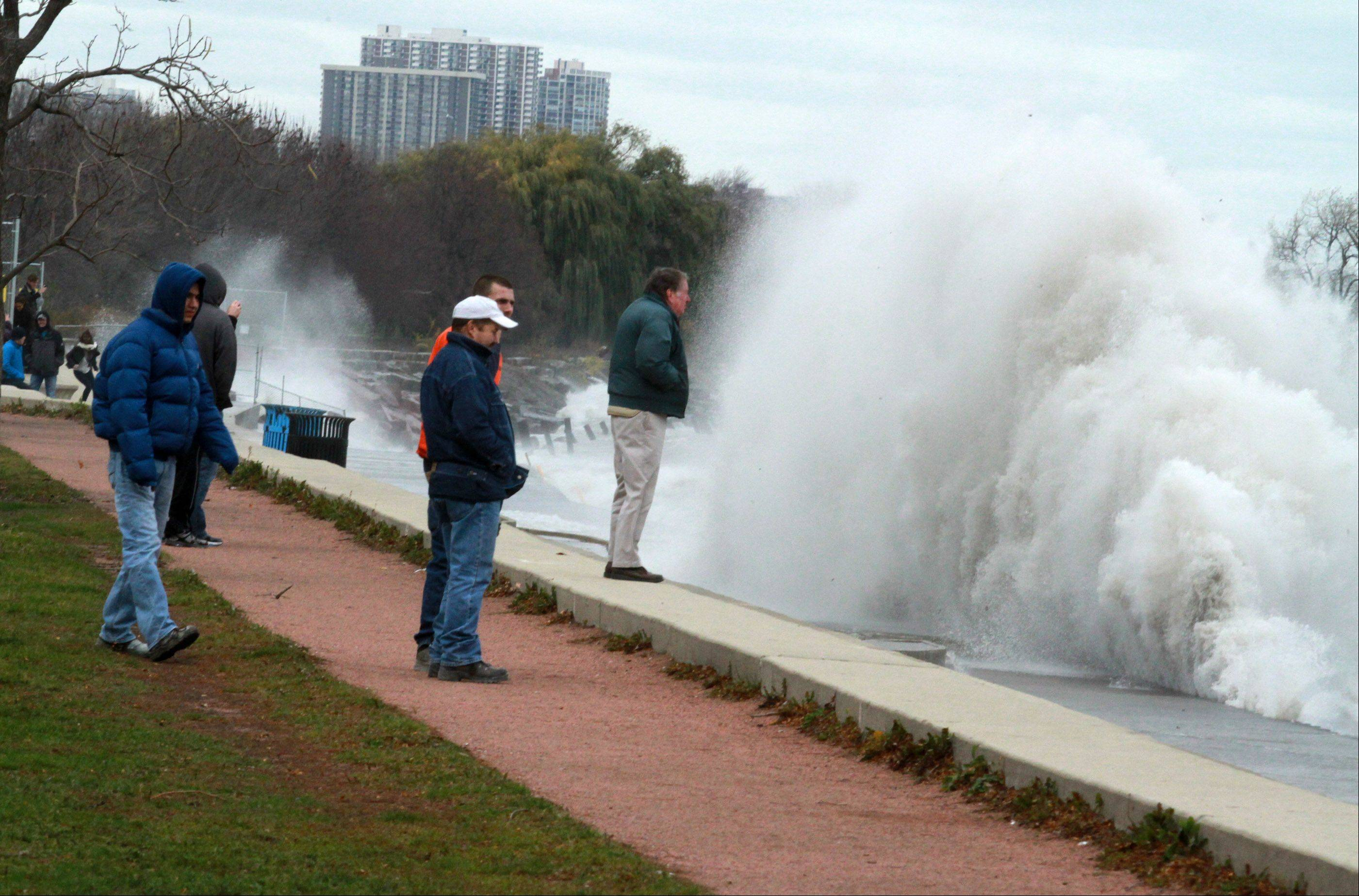 Dozens of photography enthusiast photographed waves near Sydney R. Marovitz Golf Course as giant waves batter Lake Michigan shoreline in Chicago on Tuesday, October 30.