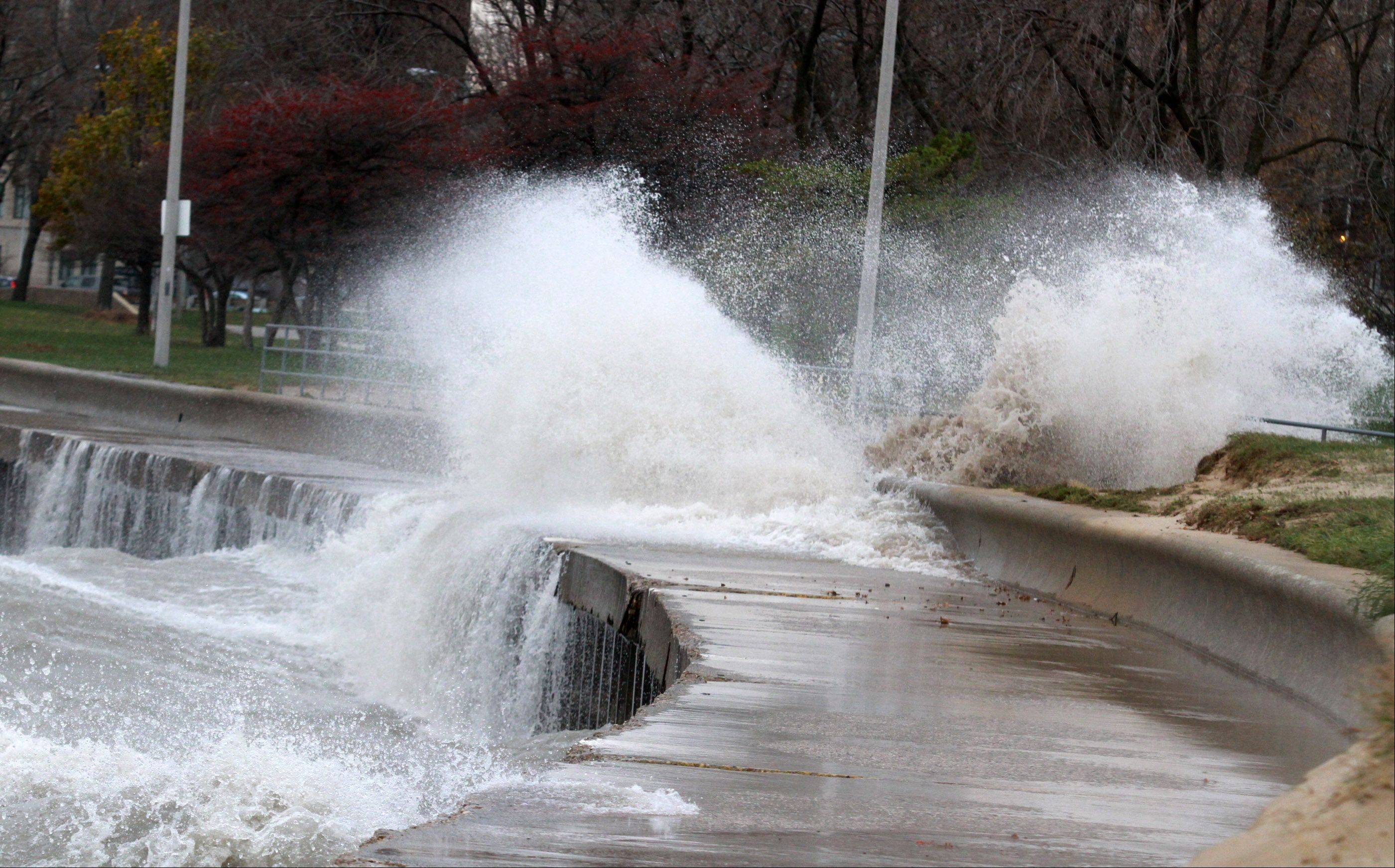 A large waves crashes of the jogging path at Montrose Beach in Chicago on Tuesday, October 30.