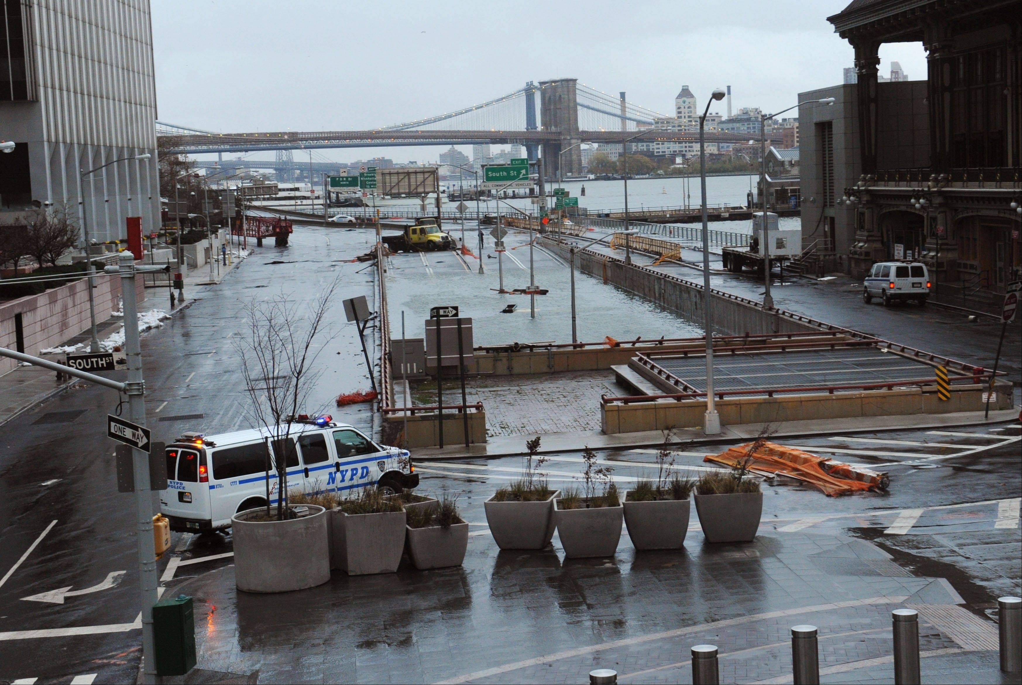 Water reaches the street level of the flooded Brooklyn Battery Tunnel, Tuesday, Oct. 30, 2012, in New York. Sandy arrived along the East Coast and morphed into a huge and problematic system, putting more than 7.5 million homes and businesses in the dark and causing a number of deaths.