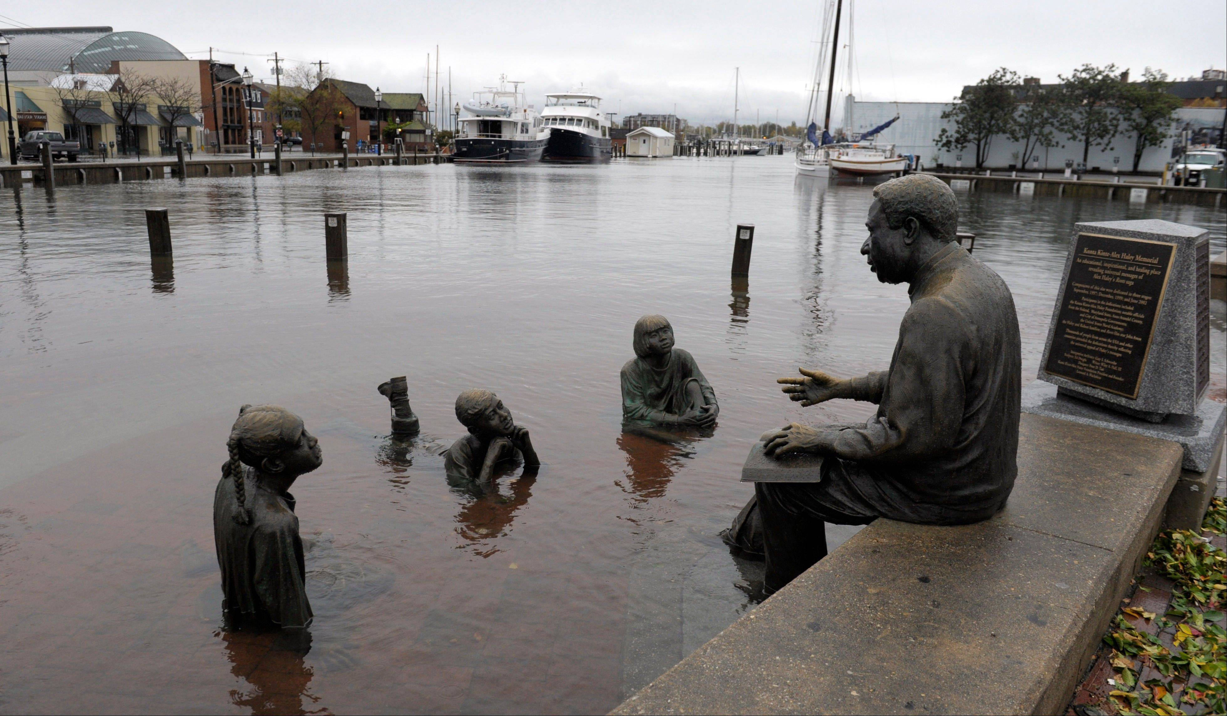 The Kunta Kinte-Alex Haley Memorial sits in floodwaters in downtown Annapolis, Md., Tuesday, Oct. 30, 2012, after the superstorm and the remnants of Hurricane Sandy passed through Annapolis.