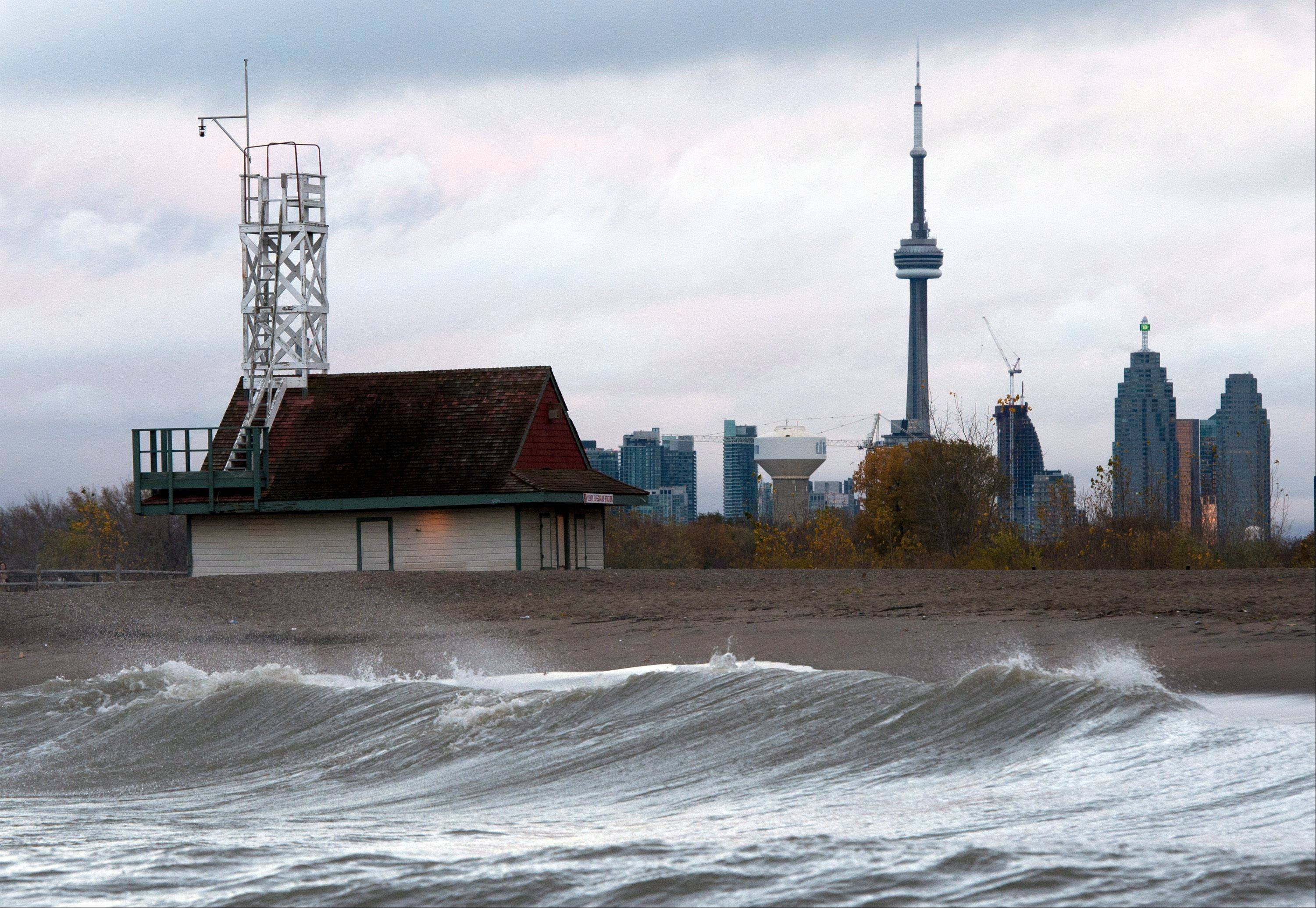 Waves driven by superstorm Sandy crash on the beach of Lake Ontario in Toronto on Tuesday morning, Oct. 30, 2012.