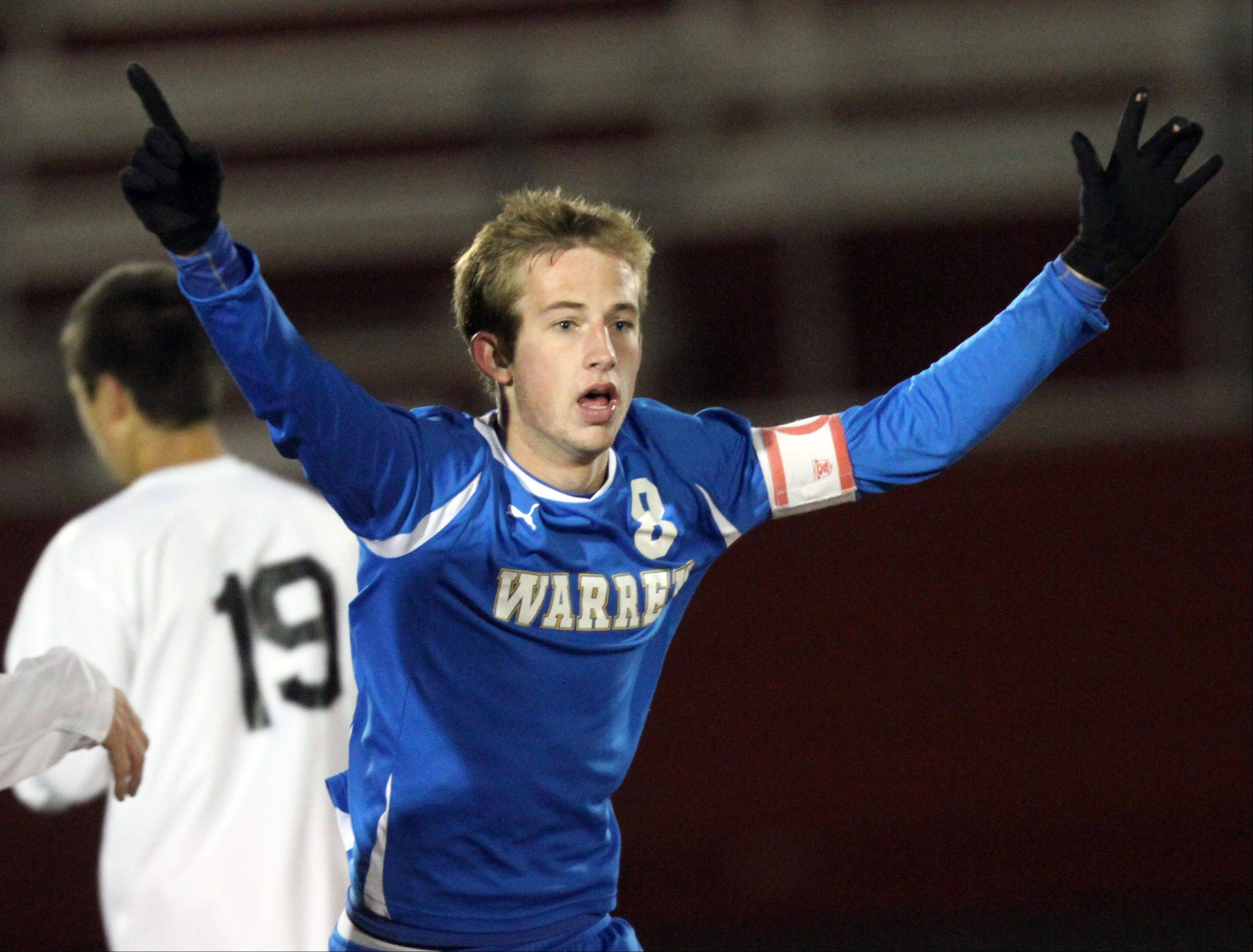 Warren's Sean Kirwan celebrates after the Blue Devils beat St. Charles East 2-1 in the super sectional final Tuesday night at Barrington High School.