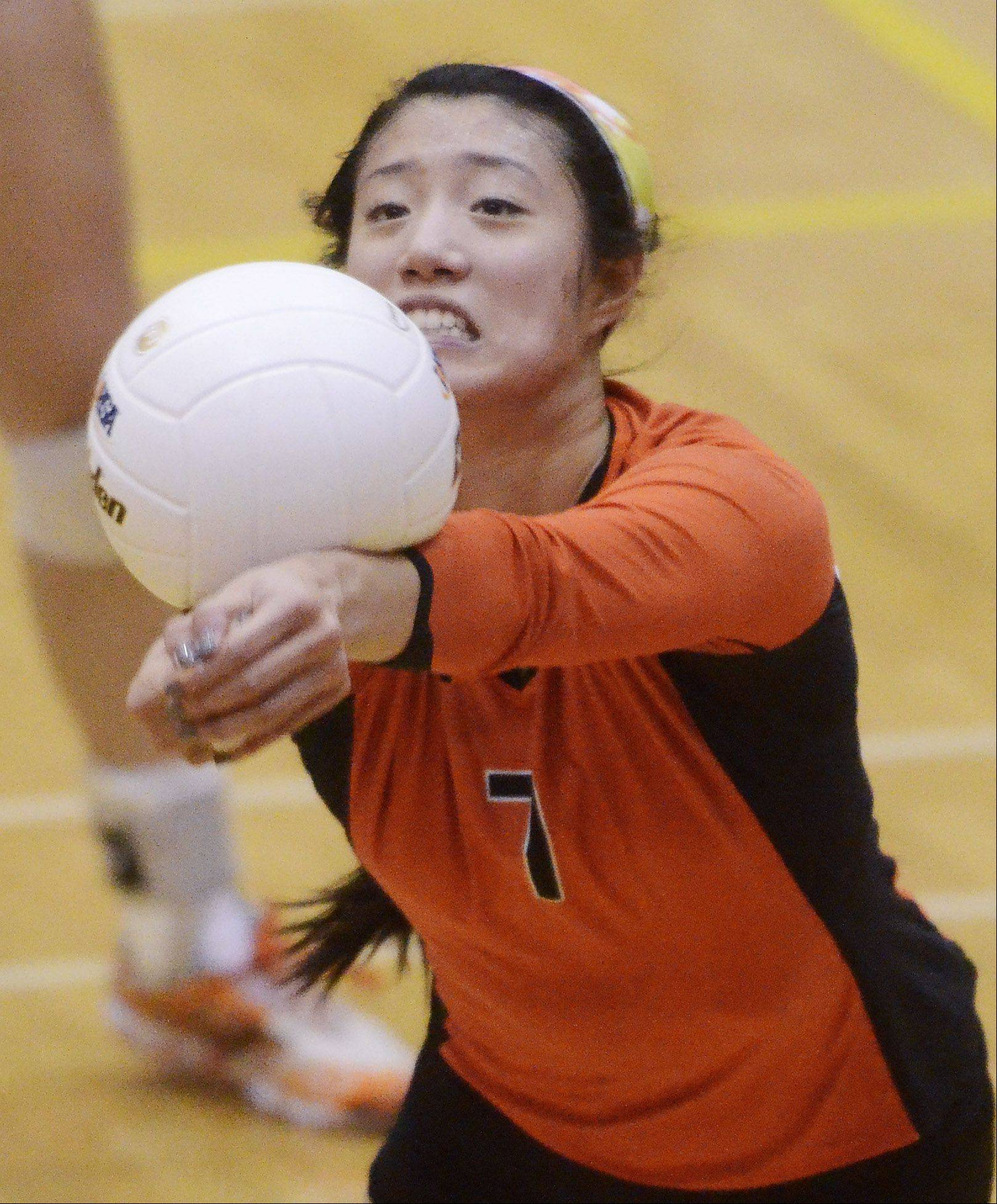Libertyville's Cindy Zhou hustles for a dig during Tuesday's sectional semifinal against Hersey at Fremd High School in Palatine.