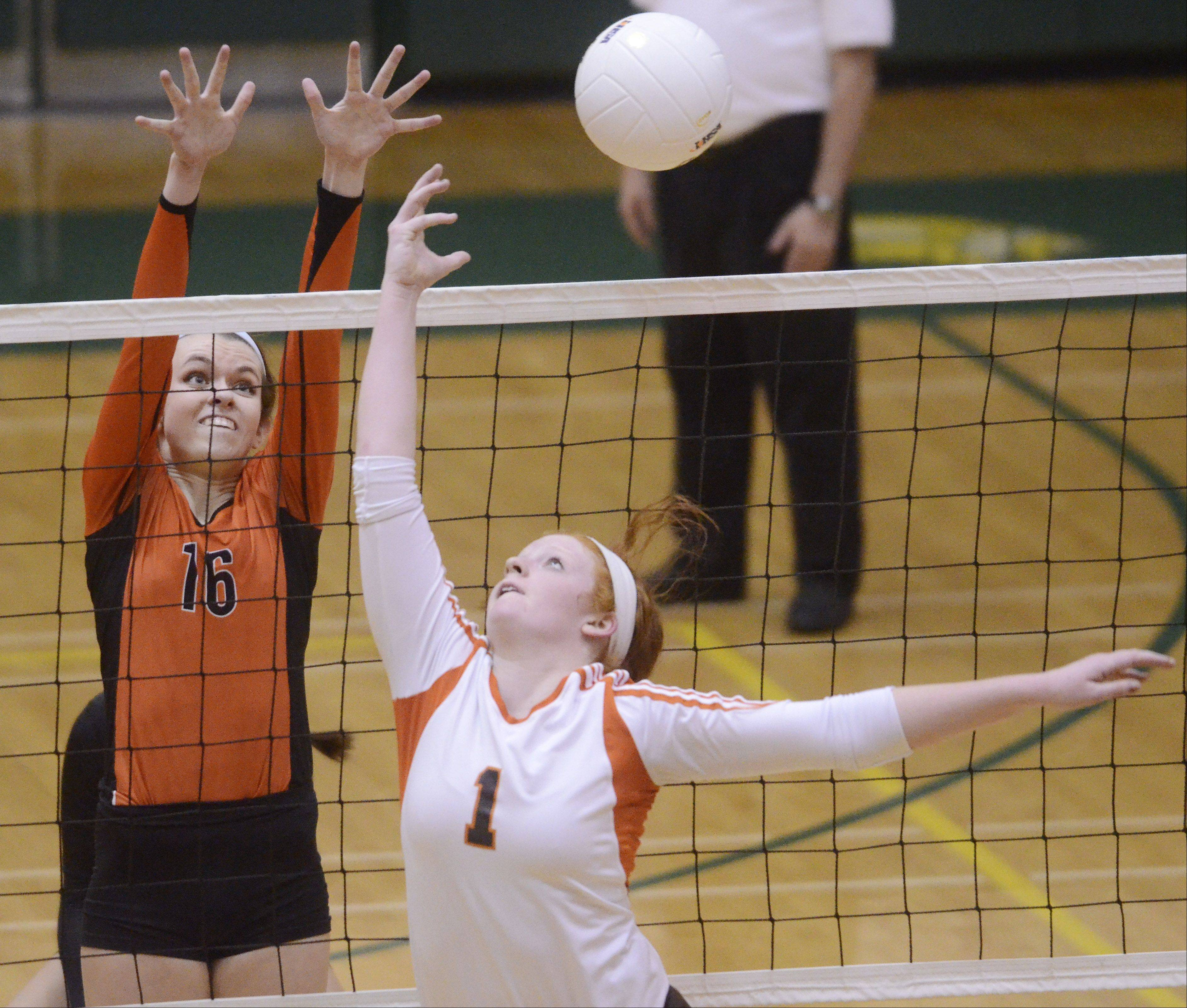 Hersey setter Abby Fesl, right, tips a ball past Libertyville's Rhiannon Prentiss during Tuesday's sectional semifinal at Fremd High School in Palatine.