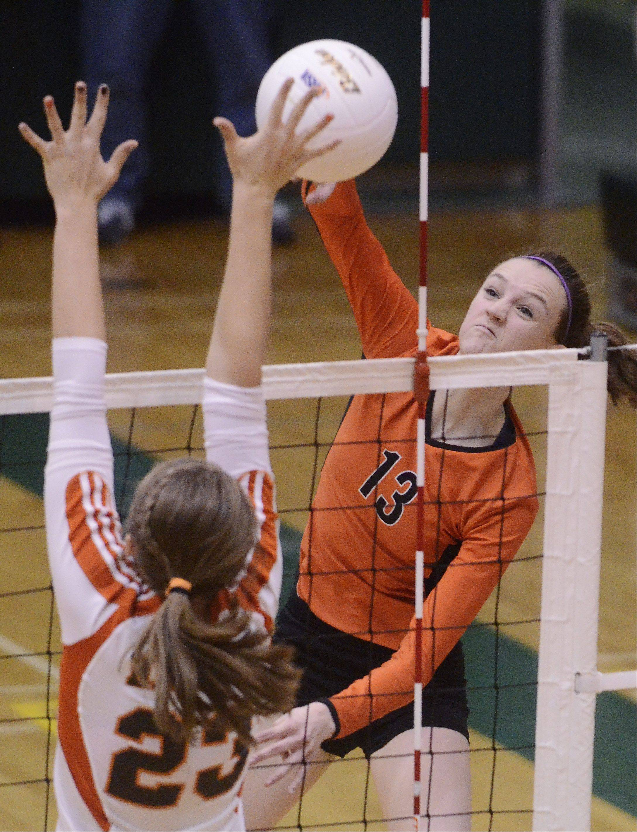 Libertyville's Julia Smagacz, right, looks for a kill as Hersey's Liz Fuerst tries to block the ball at the net during Tuesday's sectional semifinal at Fremd High School in Palatine.