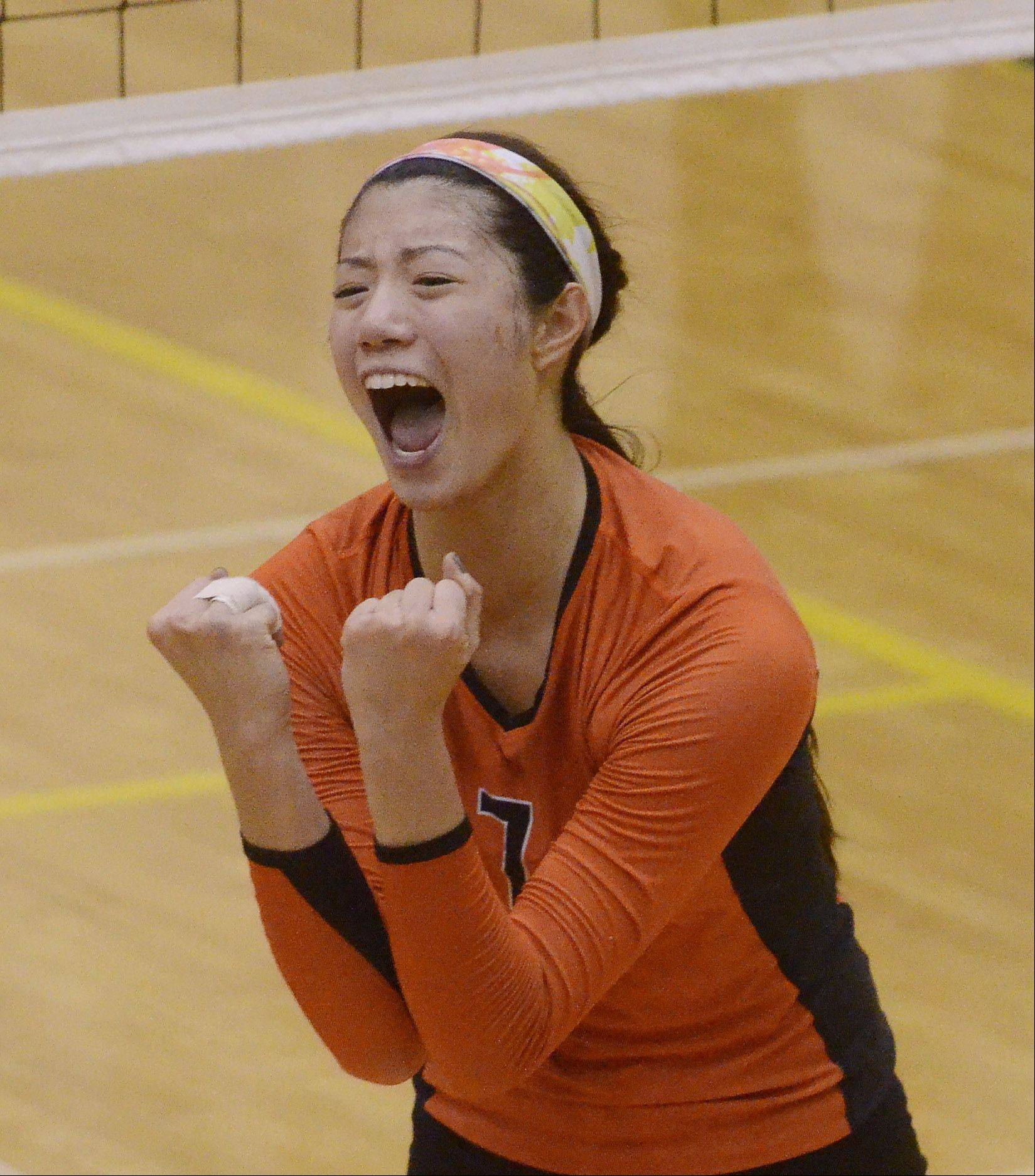Libertyville's Cindy Zhou celebrates as her team nears victory against Hersey during Tuesday's sectional semifinal at Fremd High School in Palatine.