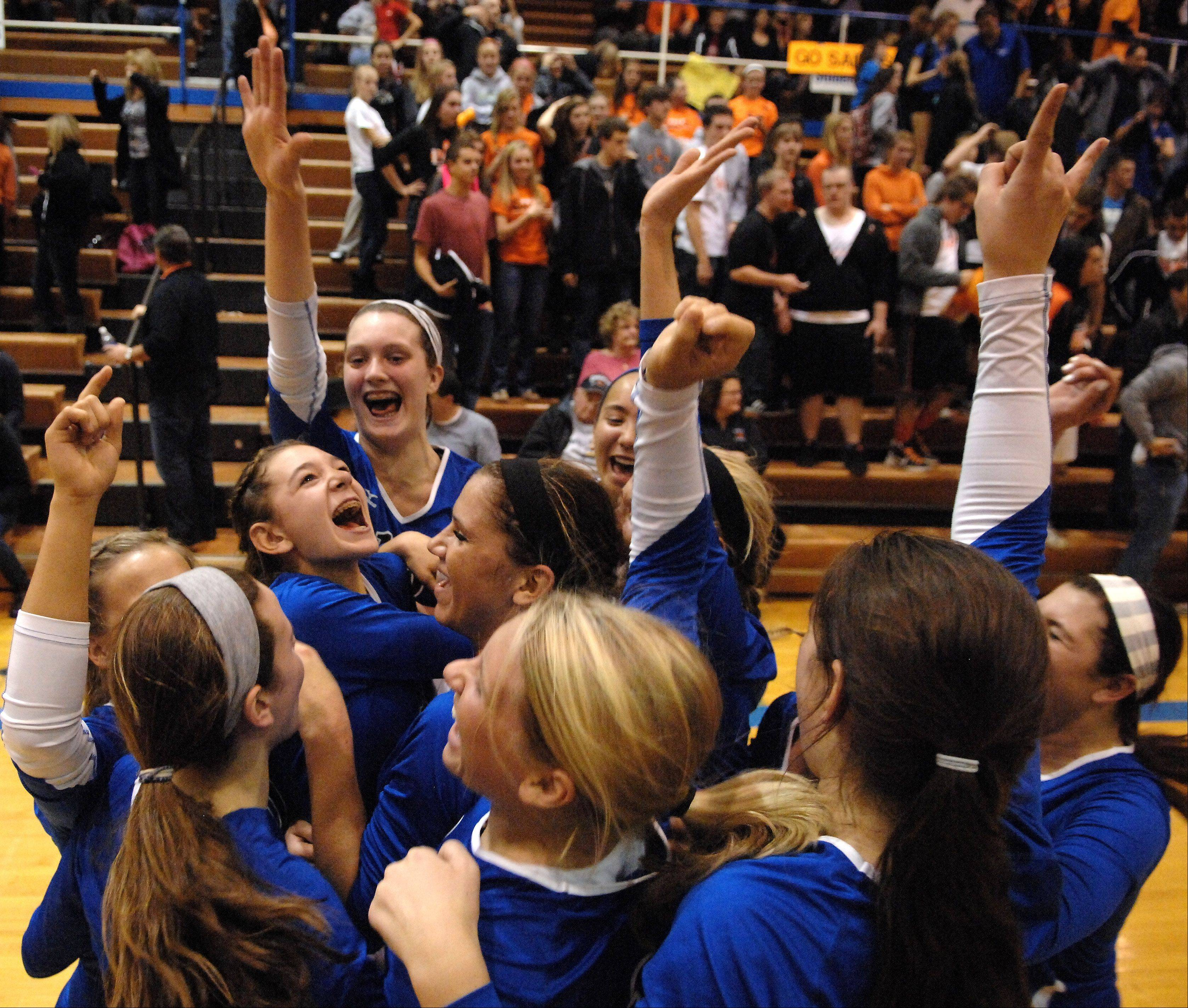 Geneva players celebrate following their victory over St. Charles East during Tuesday's sectional semifinals at Larkin High School in Elgin.