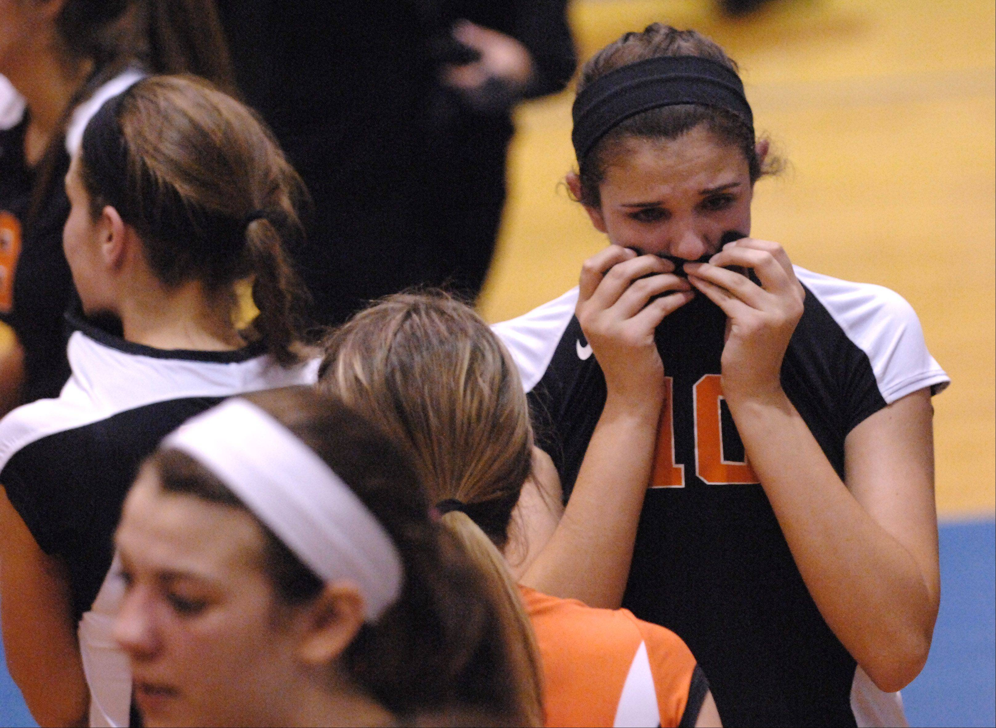 St. Charles East's Mikaela Mosquera gets emotional following the Saints loss to Geneva during Tuesday's sectional semifinals at Larkin High School in Elgin.