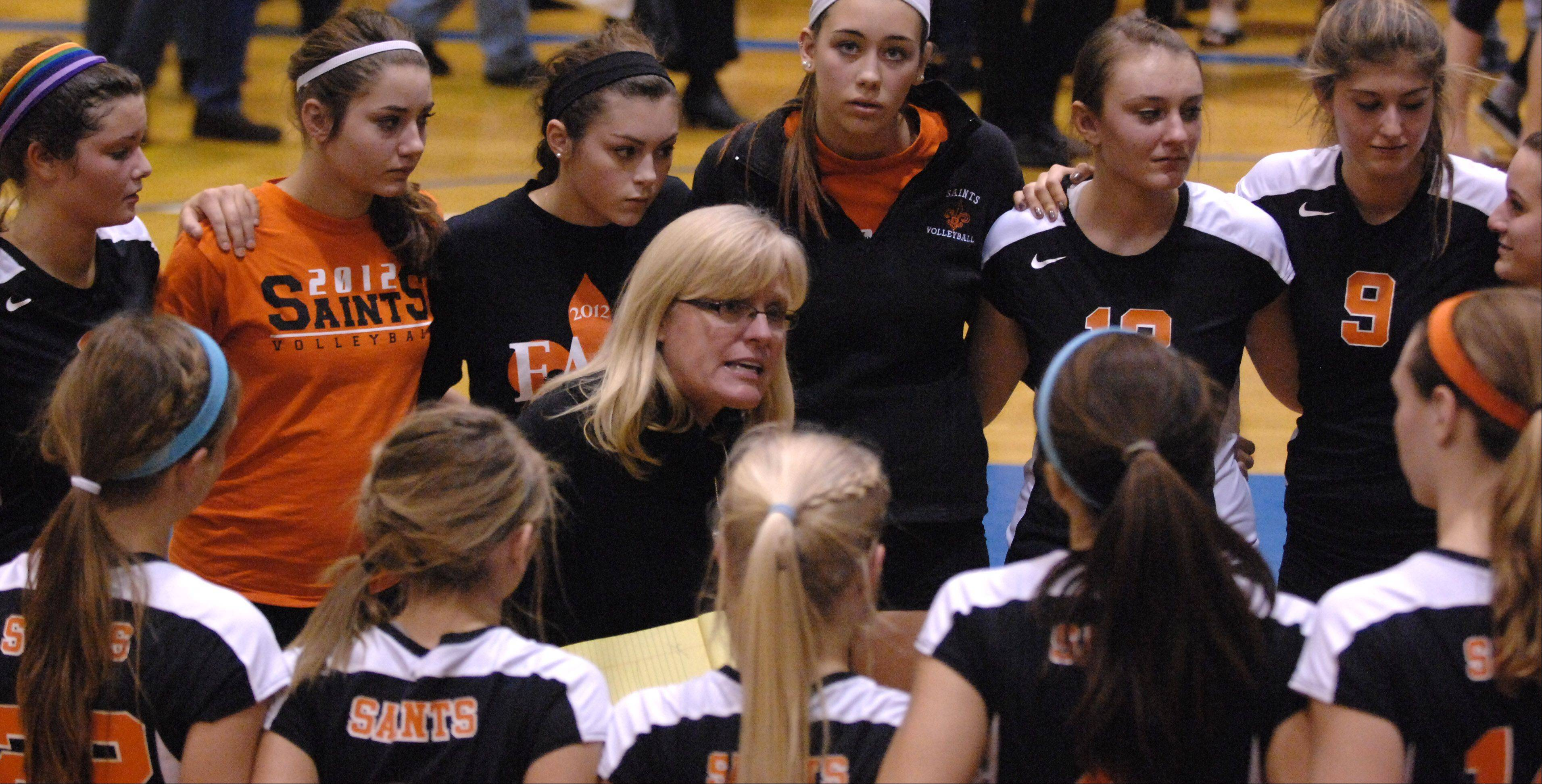 St. Charles East coach Jennie Kull congratulates her team on their season following their loss to Geneva during Tuesday's sectional semifinals at Larkin High School in Elgin.
