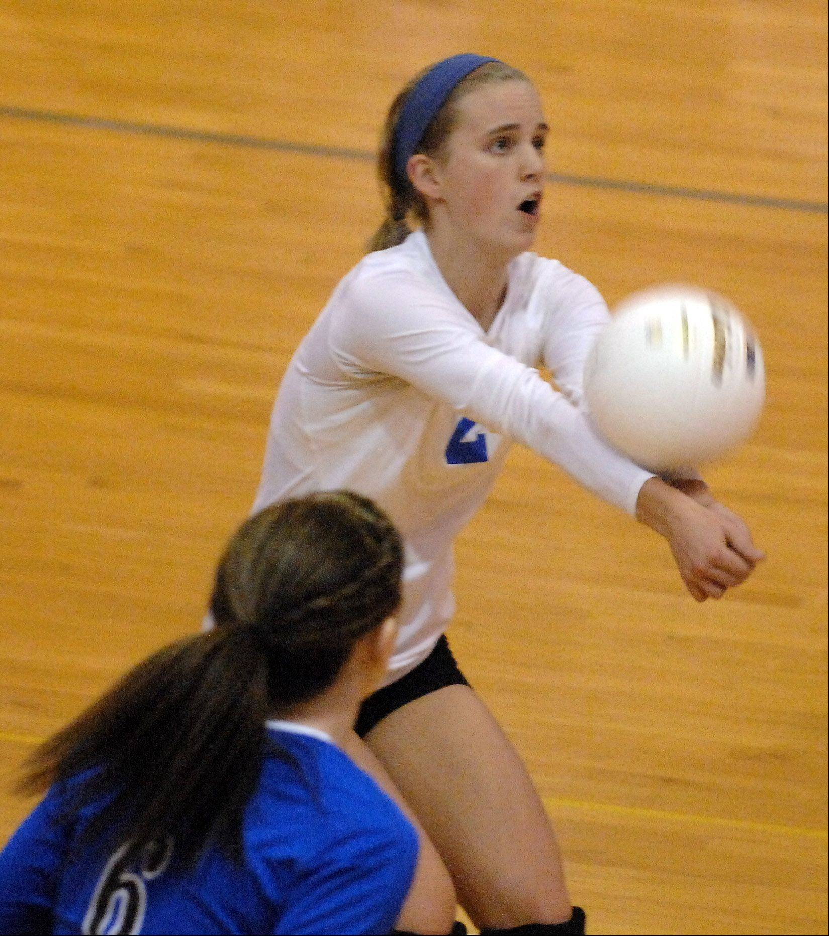 Geneva's Kelly Dalheim returns serve during Tuesday's sectional semifinals at Larkin High School in Elgin.