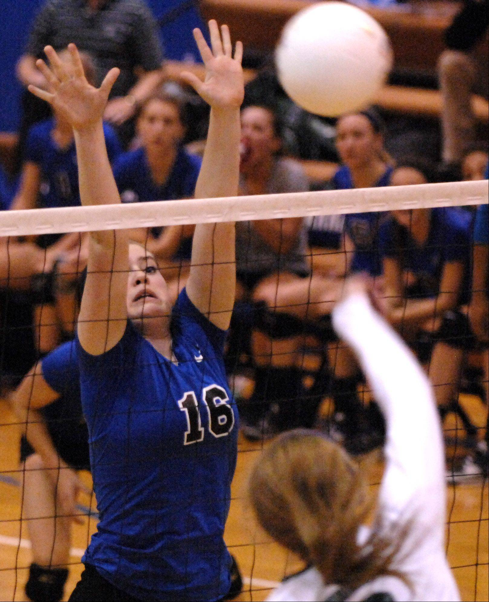 St. Charles North's Corrinne Sullivan goes up for a block against Glenbard West during Tuesday's sectional semifinals at Larkin High School in Elgin.