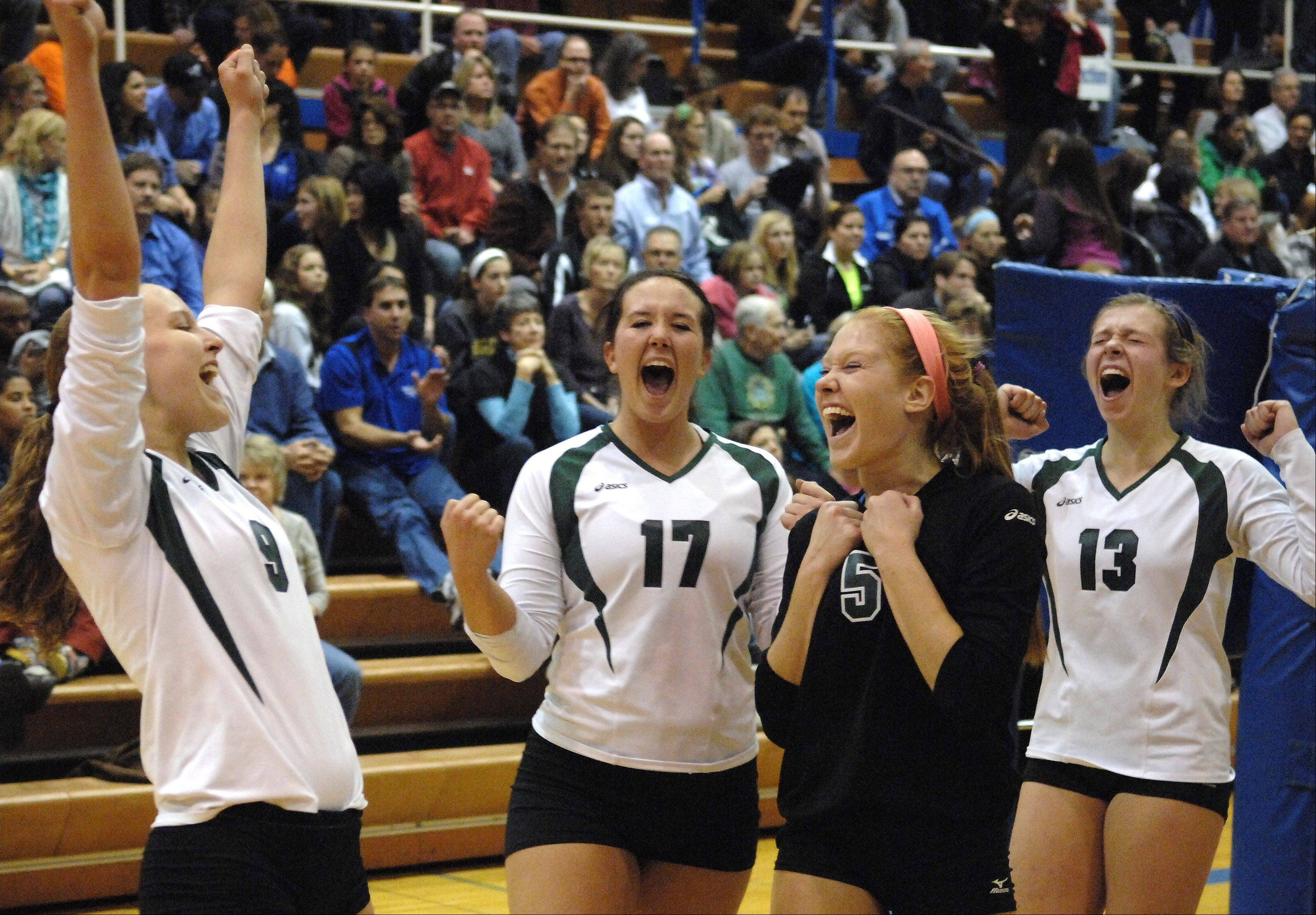 Glenbard West players, from left, Amanda Perry, Caroline Jenkins, Meg Demaar and Megan Wagner celebrate their win over St. Charles North during Tuesday's sectional semifinals at Larkin High School in Elgin.
