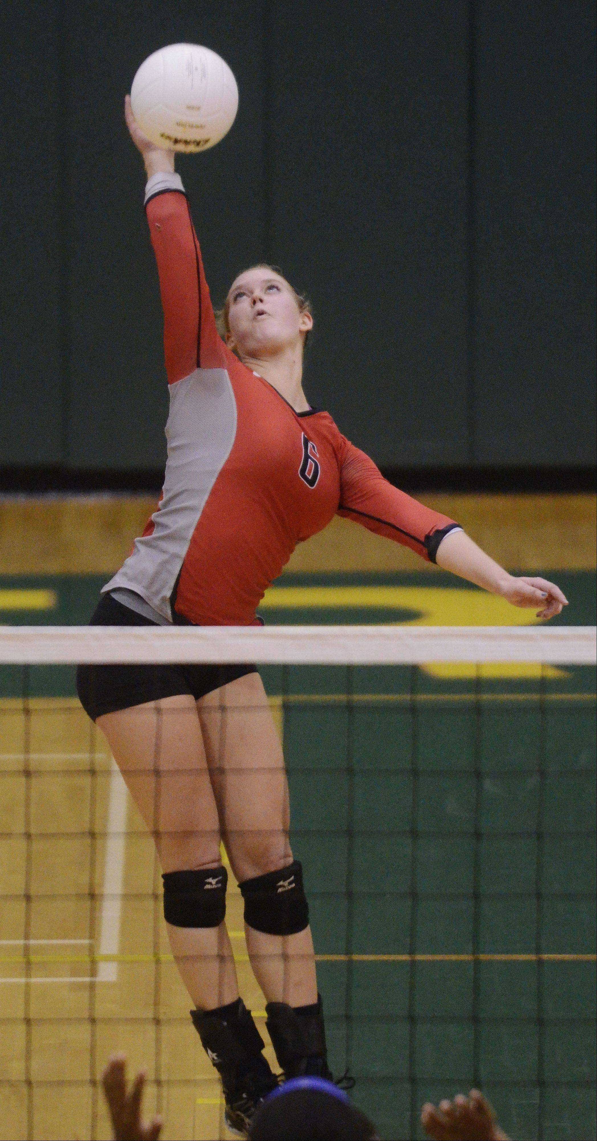 Palatine's Cassie Chaplinsky leaps on a kill attempt during Tuesday's sectional semifinal against Stevenson.