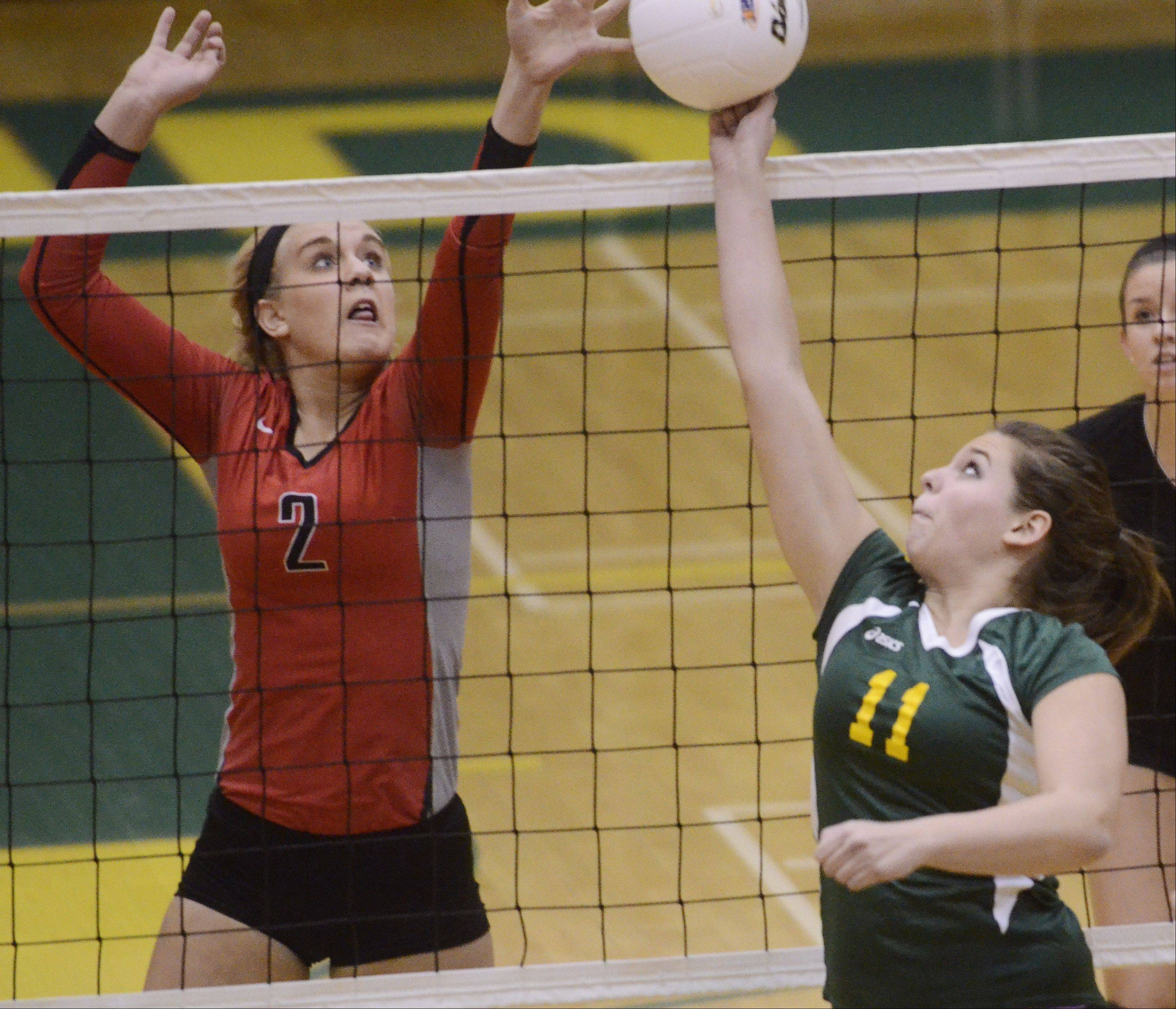 Stevenson's Alexa Bykowski, right, tries to tip the ball past Palatine's Hannah Bridier during Tuesday's sectional semifinal at Fremd.
