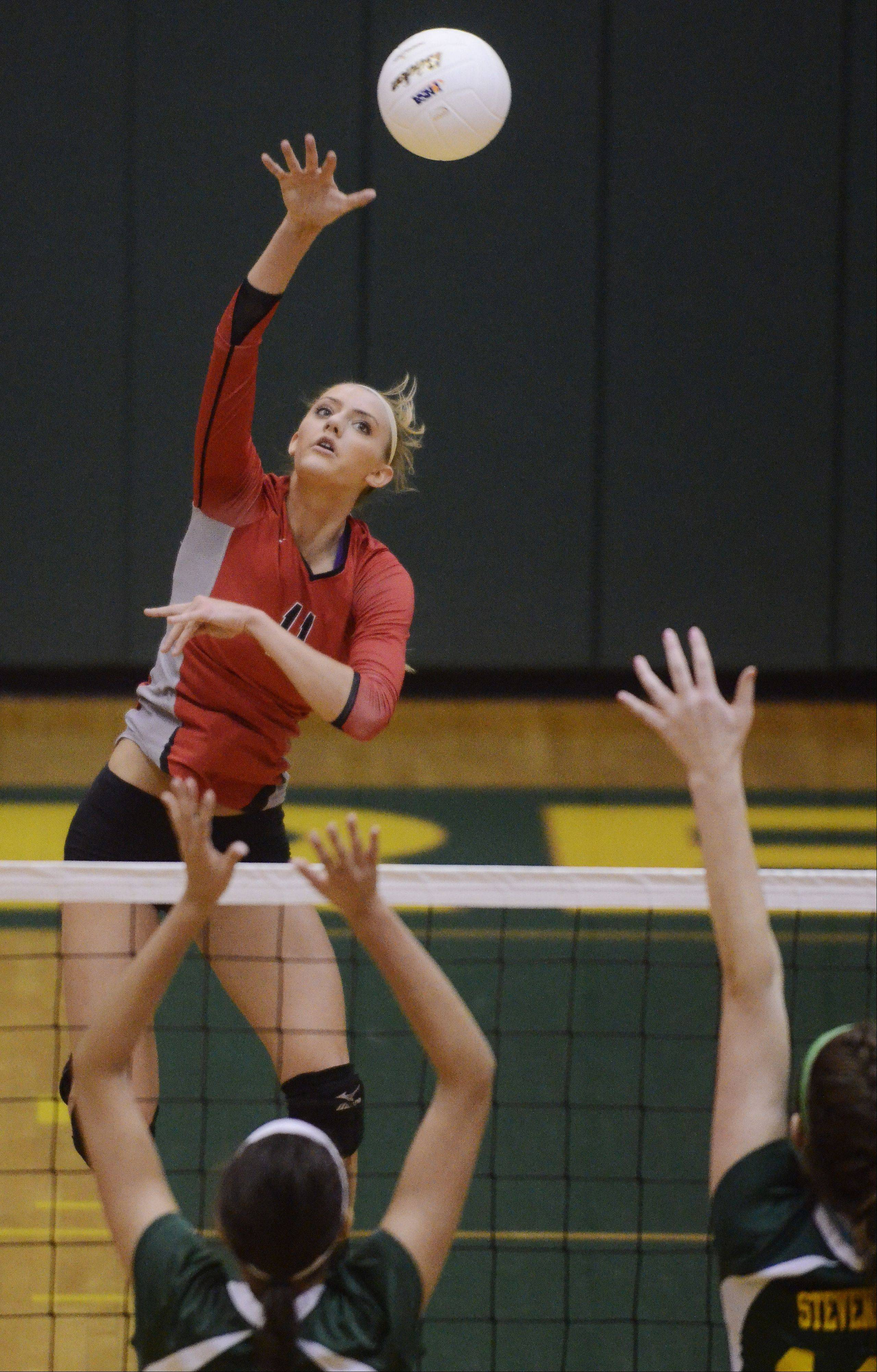Palatine's Taylor Fricano attempts a kill during Tuesday's sectional semifinal against Stevenson.