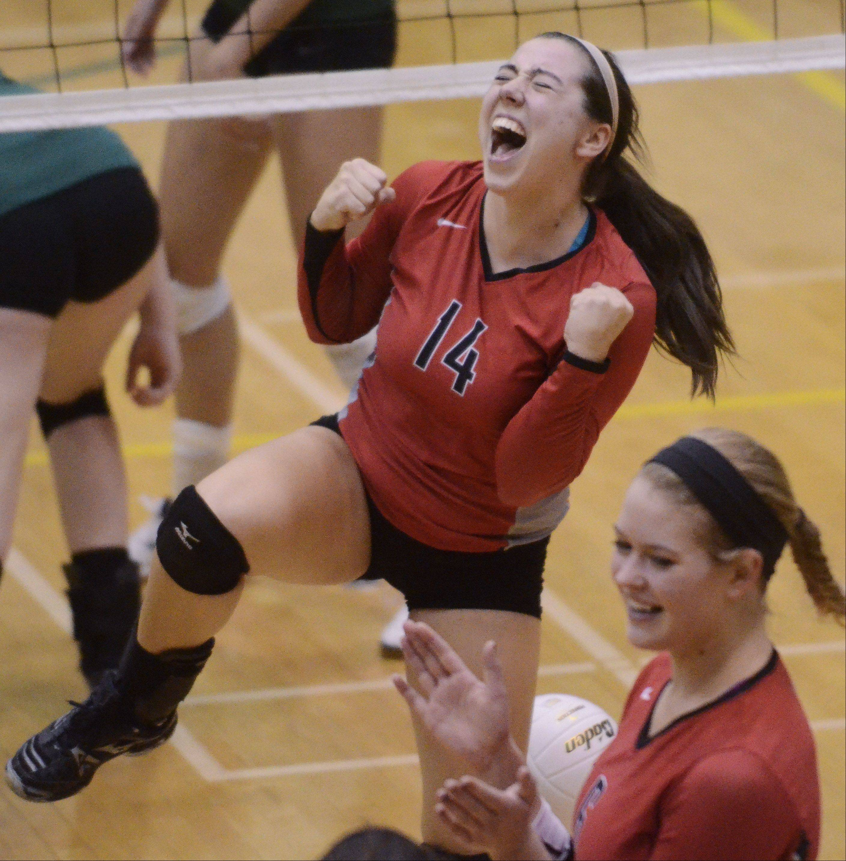 Palatine's Sarah Schiffner celebrates after earning a tough point during Tuesday's sectional semifinal at Fremd High School in Palatine.