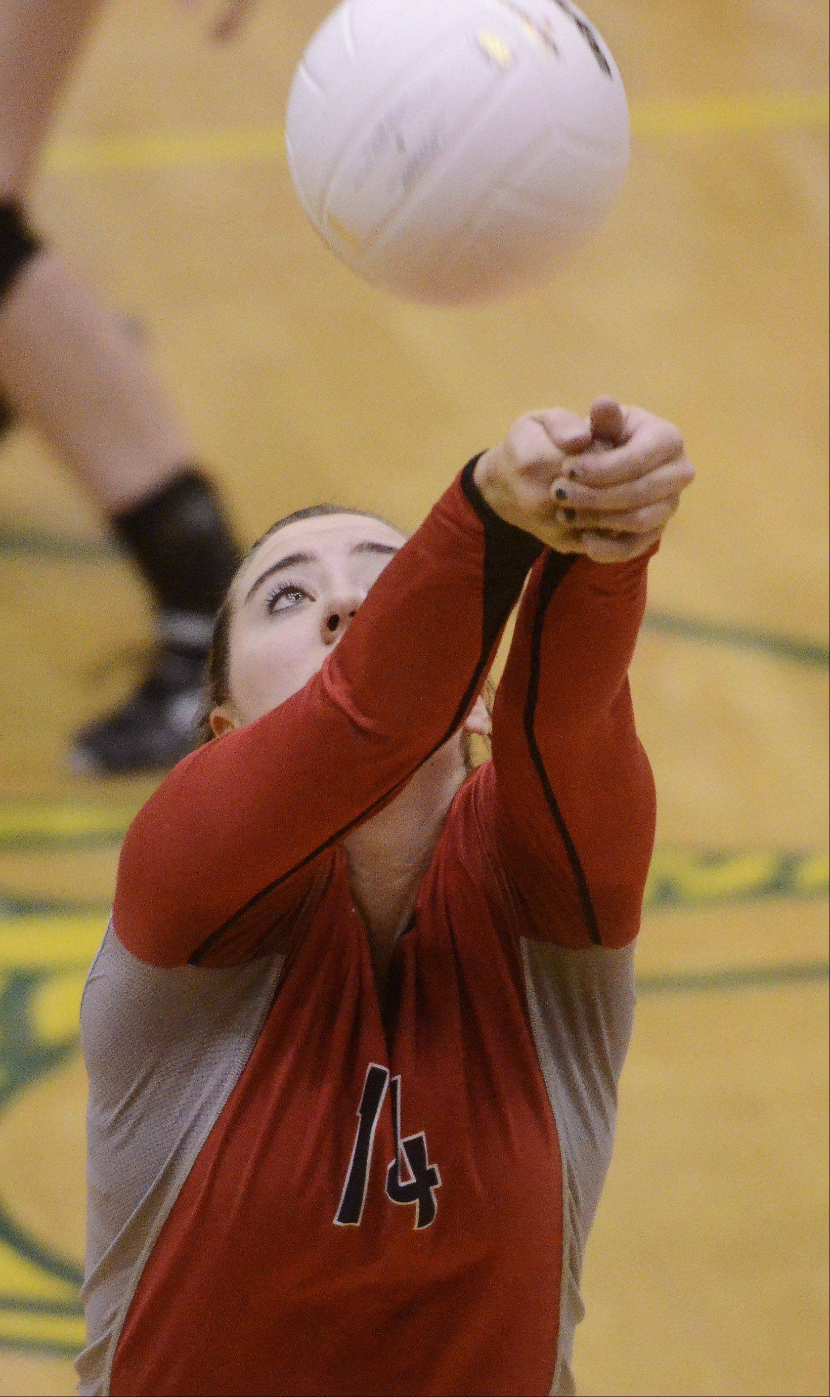 Palatine's Sarah Schiffner hustles to keep the ball in play during Tuesday's sectional semifinal against Stevenson at Fremd.