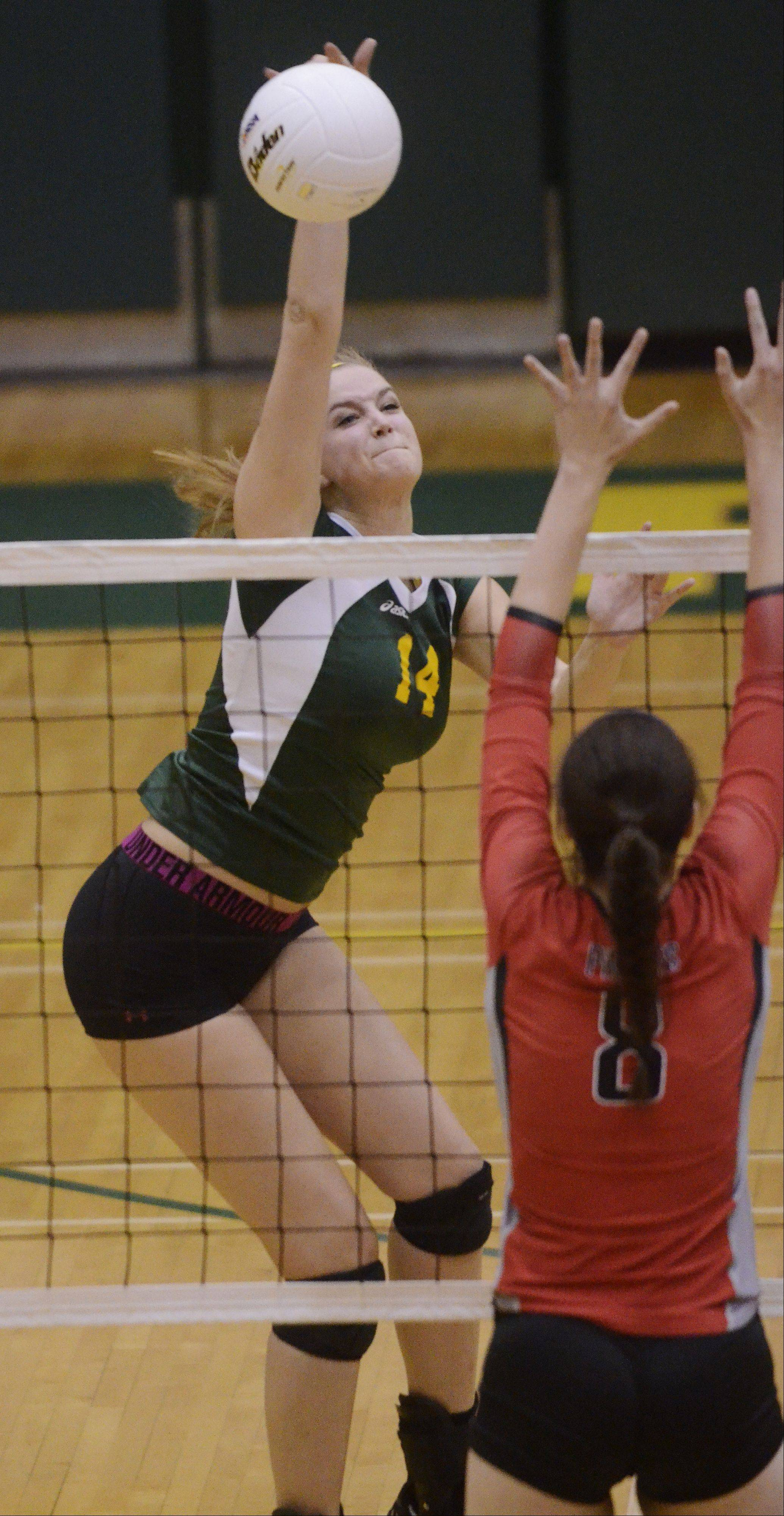 Stevenson's Kara Maleski looks for a kill as Palatine's Val Soderstrom tries to block the ball at the net during Tuesday's sectional semifinal at Fremd.