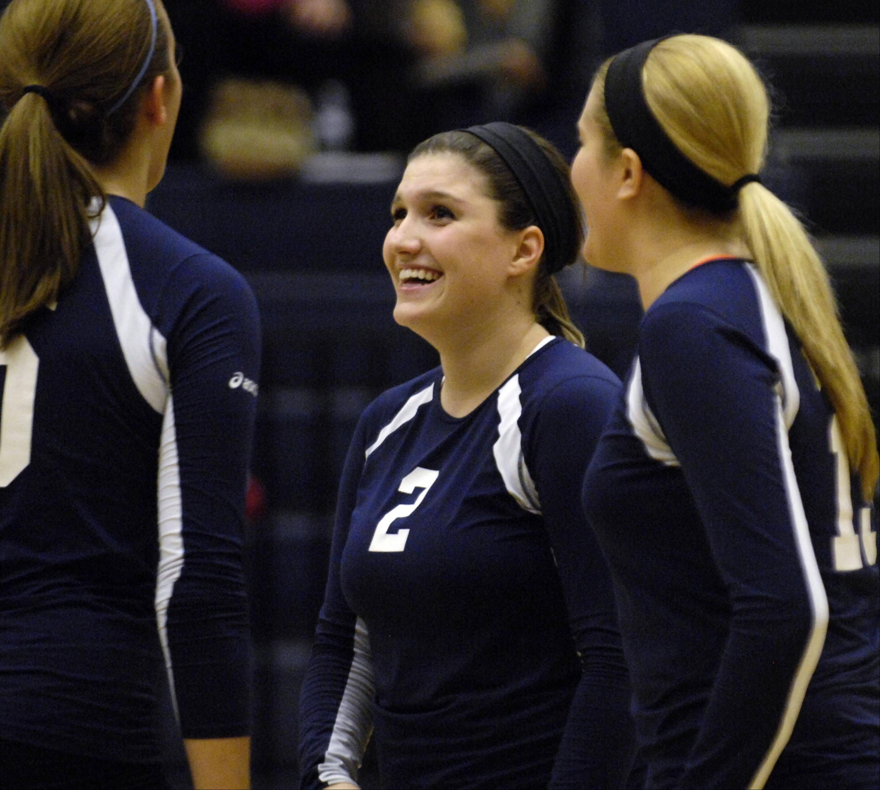 Harvest Christian Academy's Jordan Sollars laughs with teammates near the end of the match against Chicagoland Jewish during the sectional match Tuesday in Elgin.