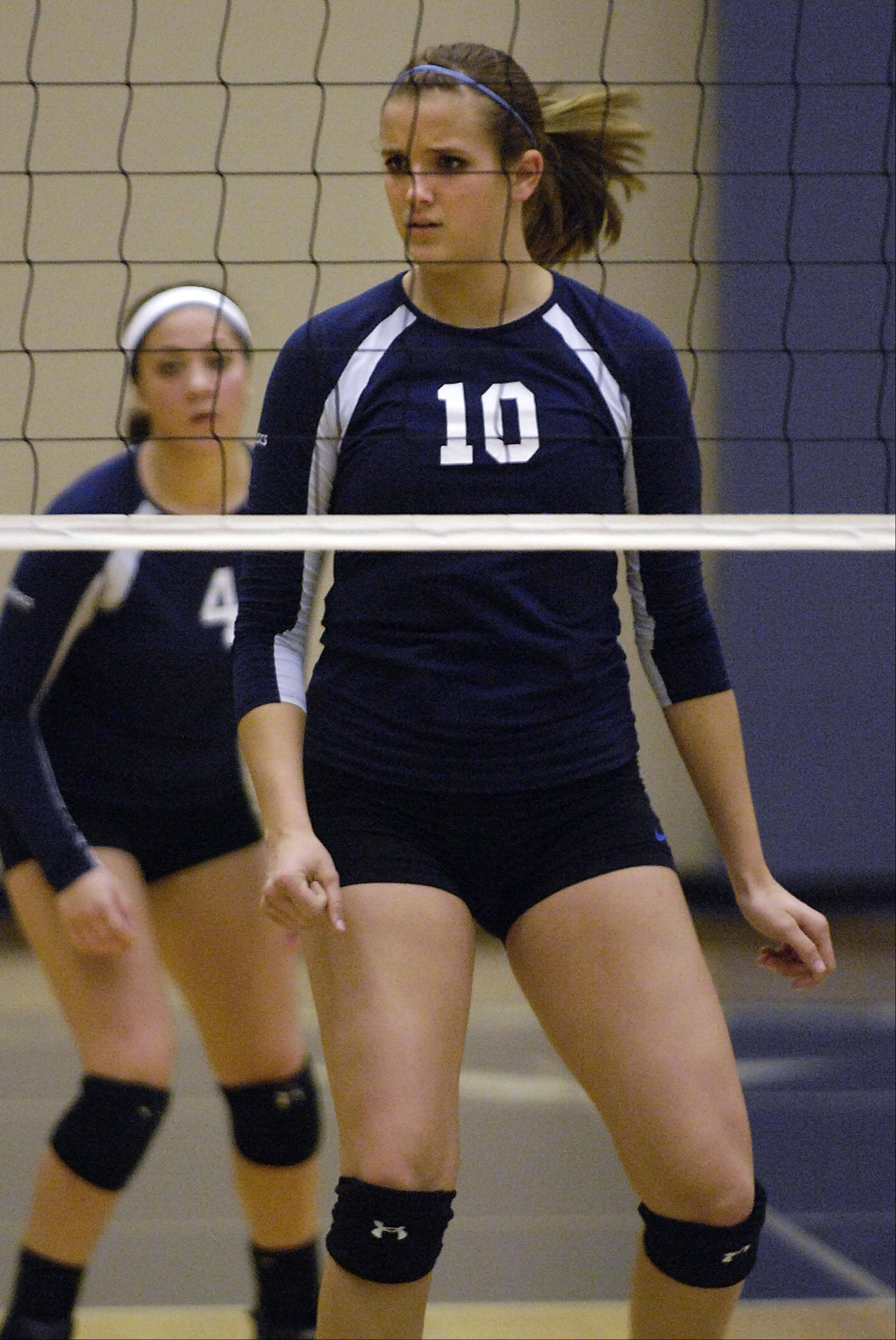 Harvest Christian Academy's Sydney Doby concentrates on the action Tuesday during the sectional match in Elgin.