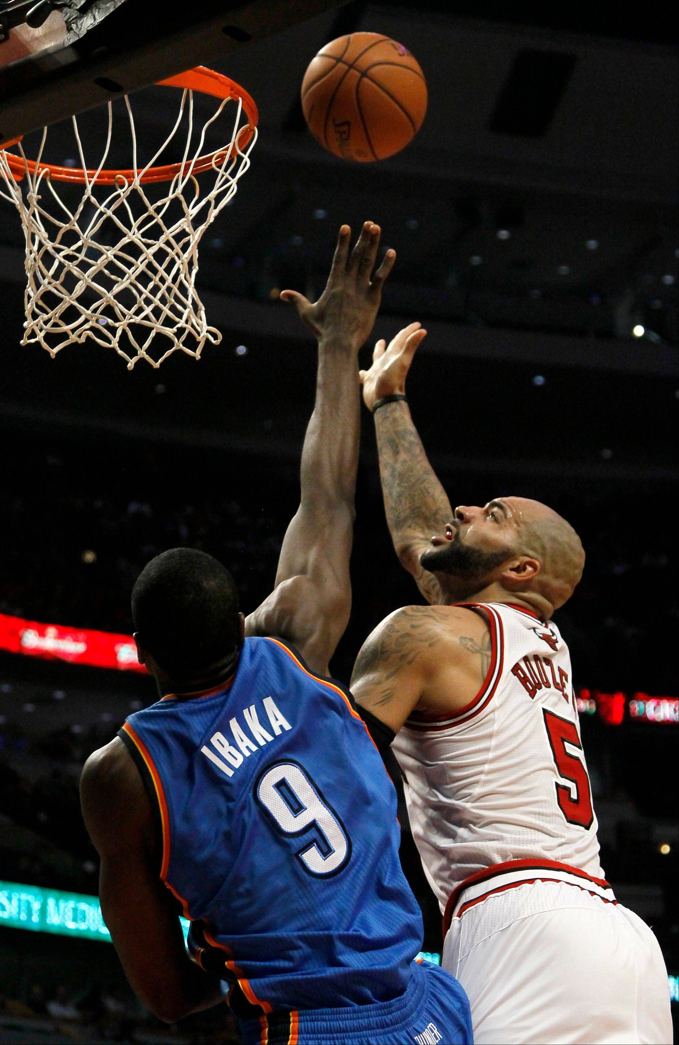 Bulls forward Carlos Boozer says it will take much more than his scoring to replace the injured Derrick Rose.