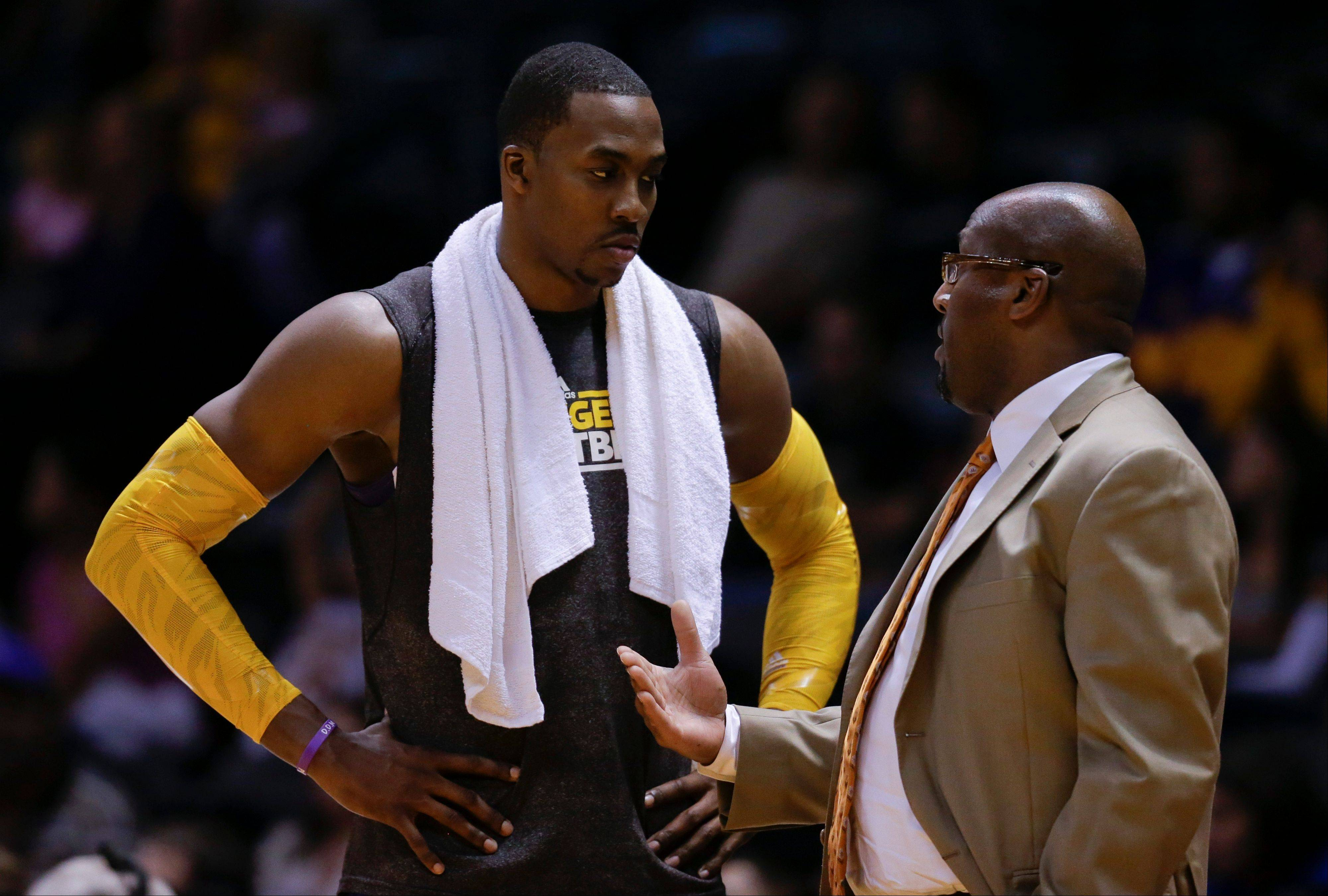 Los Angeles Lakers center Dwight Howard, left, and head coach Mike Brown will be under an intense media spotlight as the aging Lakers try to rebuild with Howard.