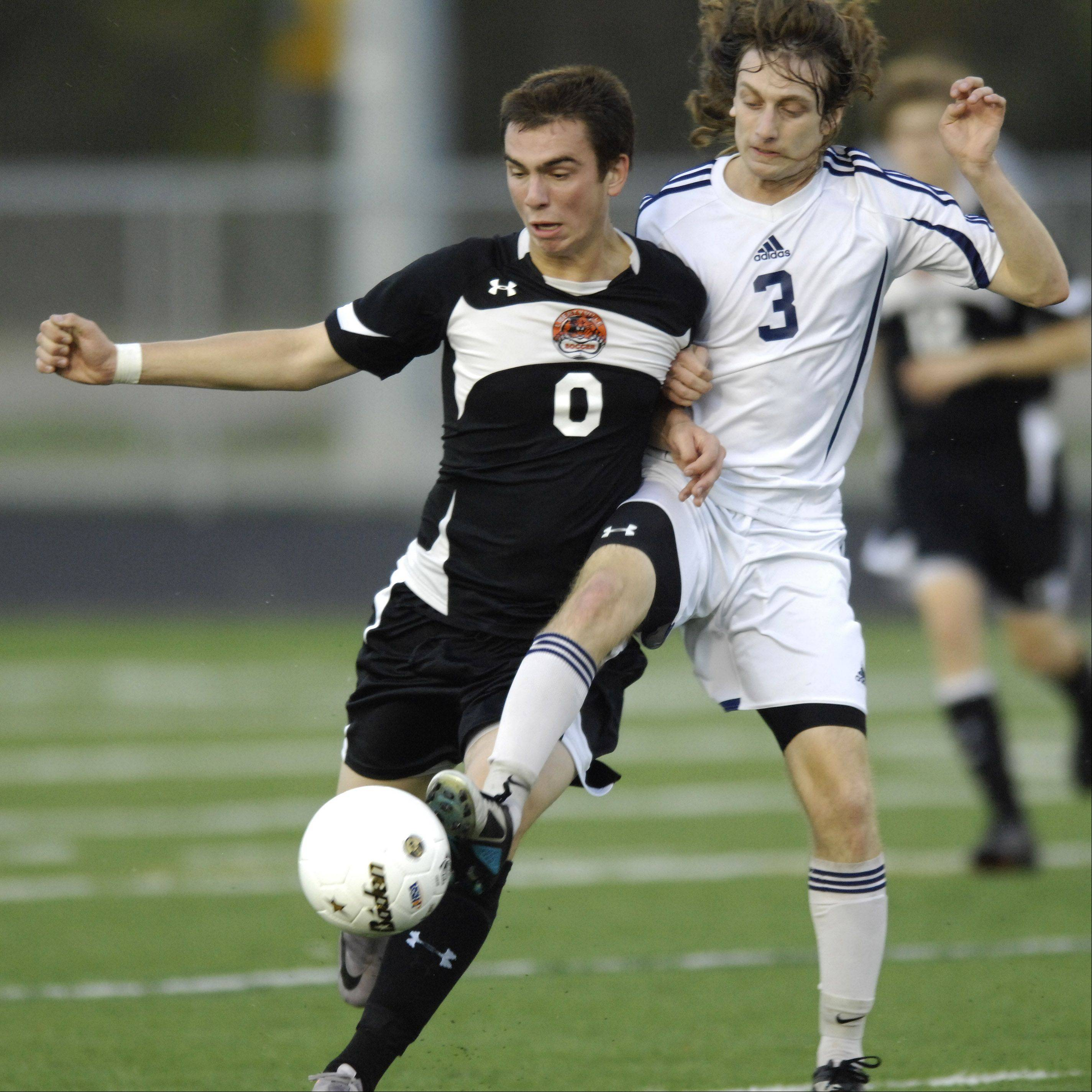 Libertyville's Austin Bitta, left, and Prospect's Avi Chitman make contact as they pursue the ball during Tuesday's sectional semifinal at Conant.