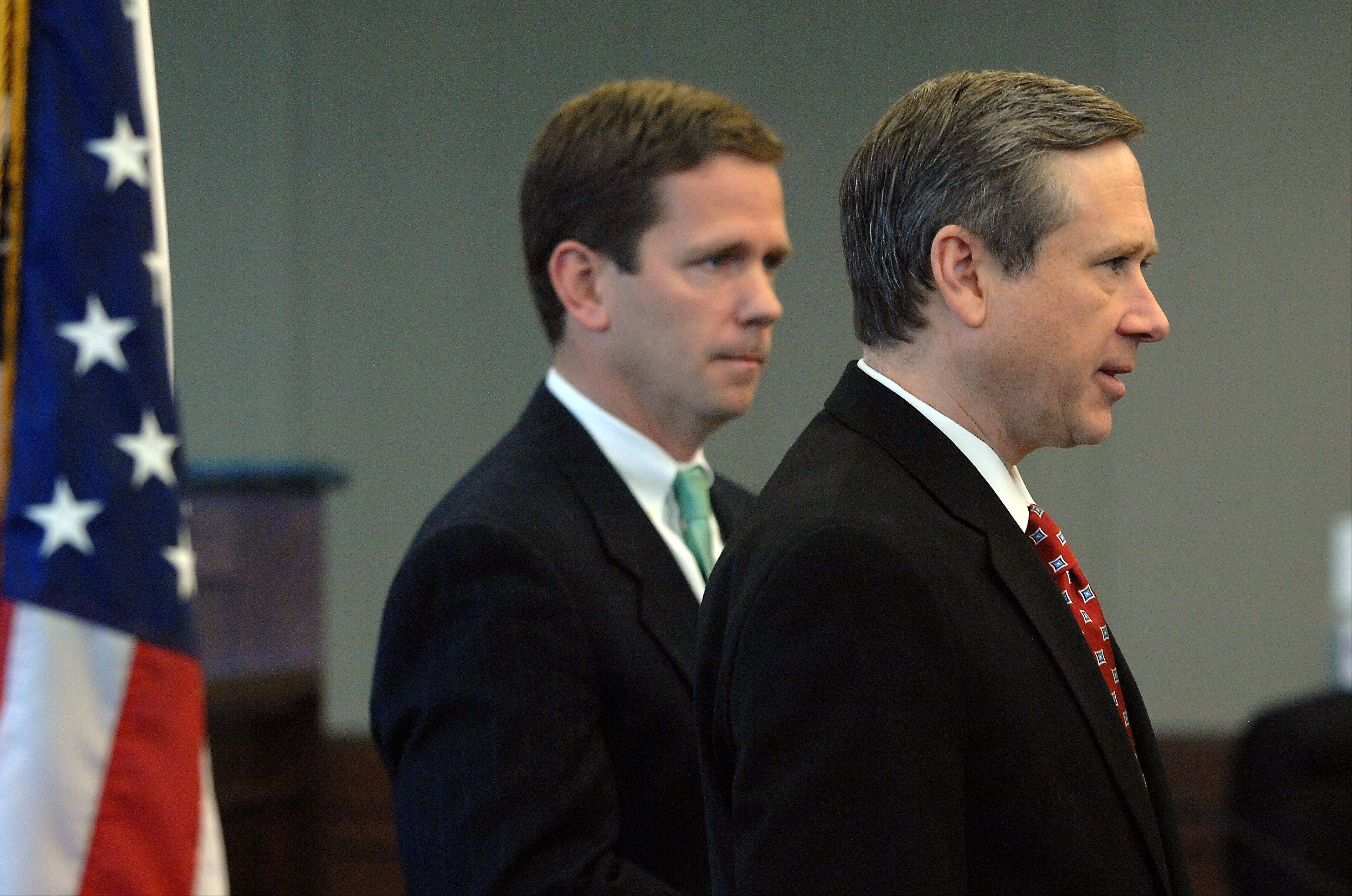 U.S. Sen. Mark Kirk, shown before his stroke in January, stands with Republican Rep. Bob Dold, at left.