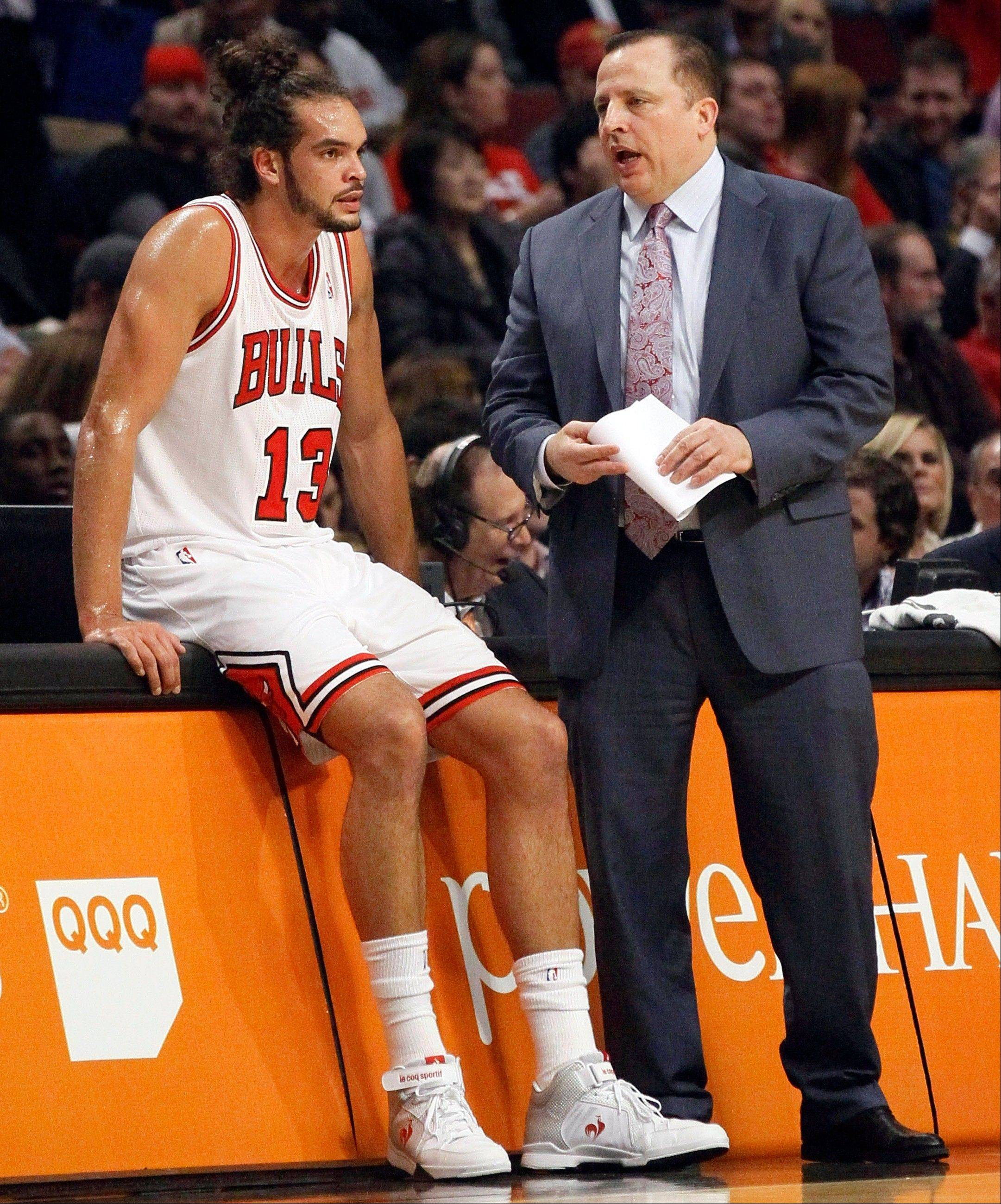 Bulls head coach Tom Thibodeau, right, talks to center Joakim Noah Wednesday during a break in the first half against the Sacramento Kings at the United Center.