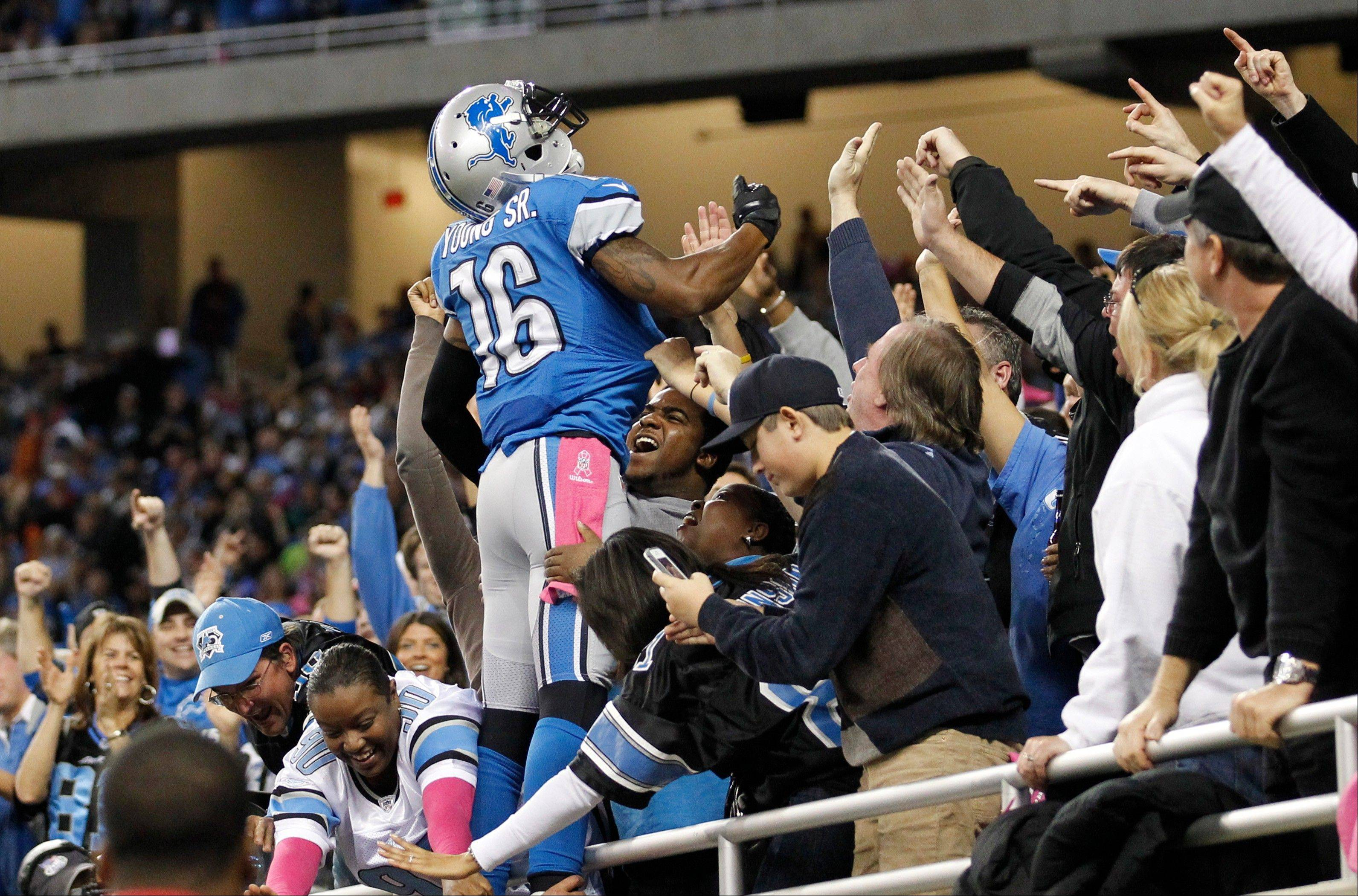 Detroit Lions wide receiver Titus Young celebrates his touchdown with fans Sunday during the first half against the Seattle Seahawks in Detroit.