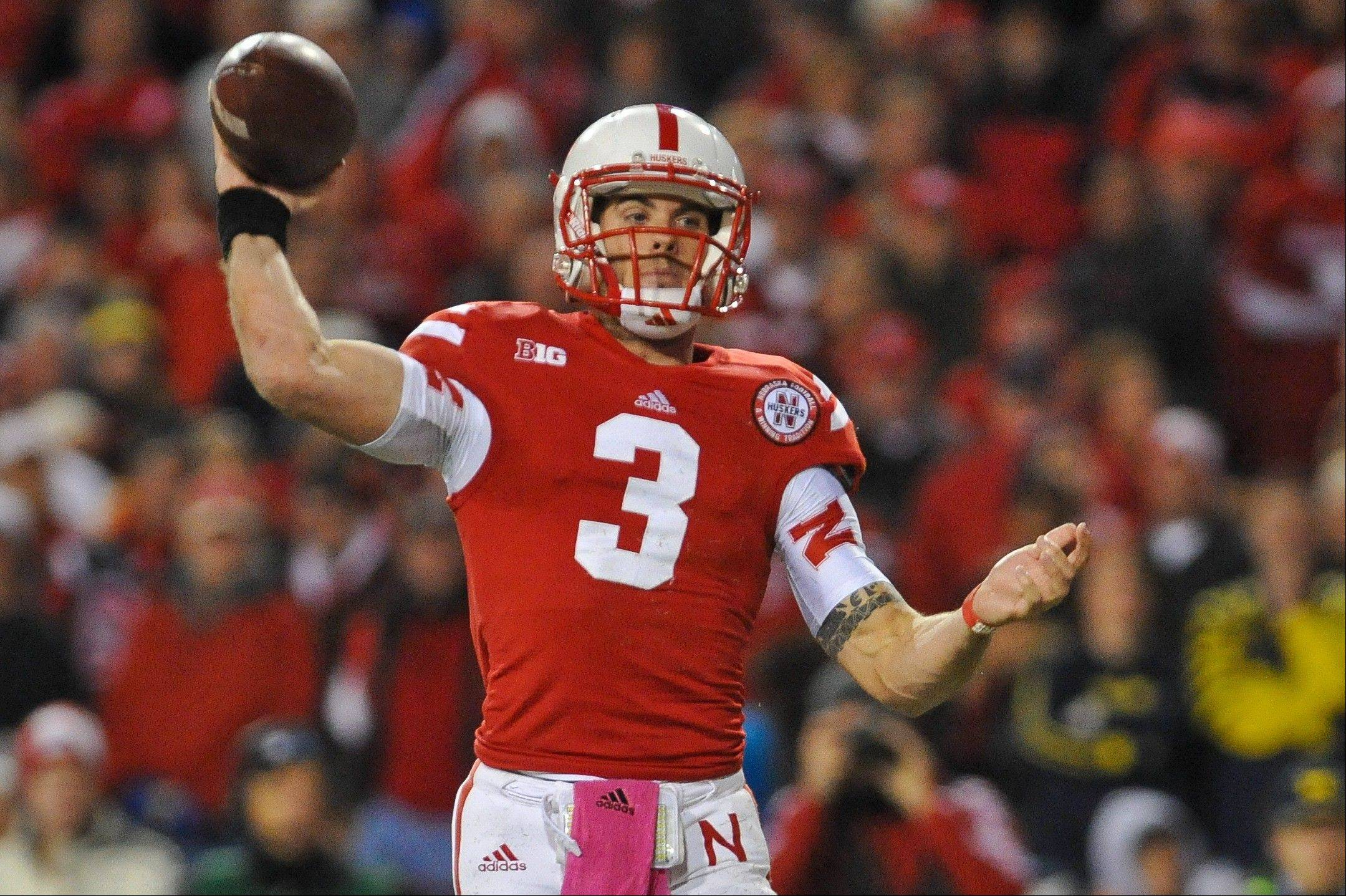 Nebraska�s Taylor Martinez throws Saturday against Michigan in Lincoln, Neb. Nebraska beat Michigan 23-9.