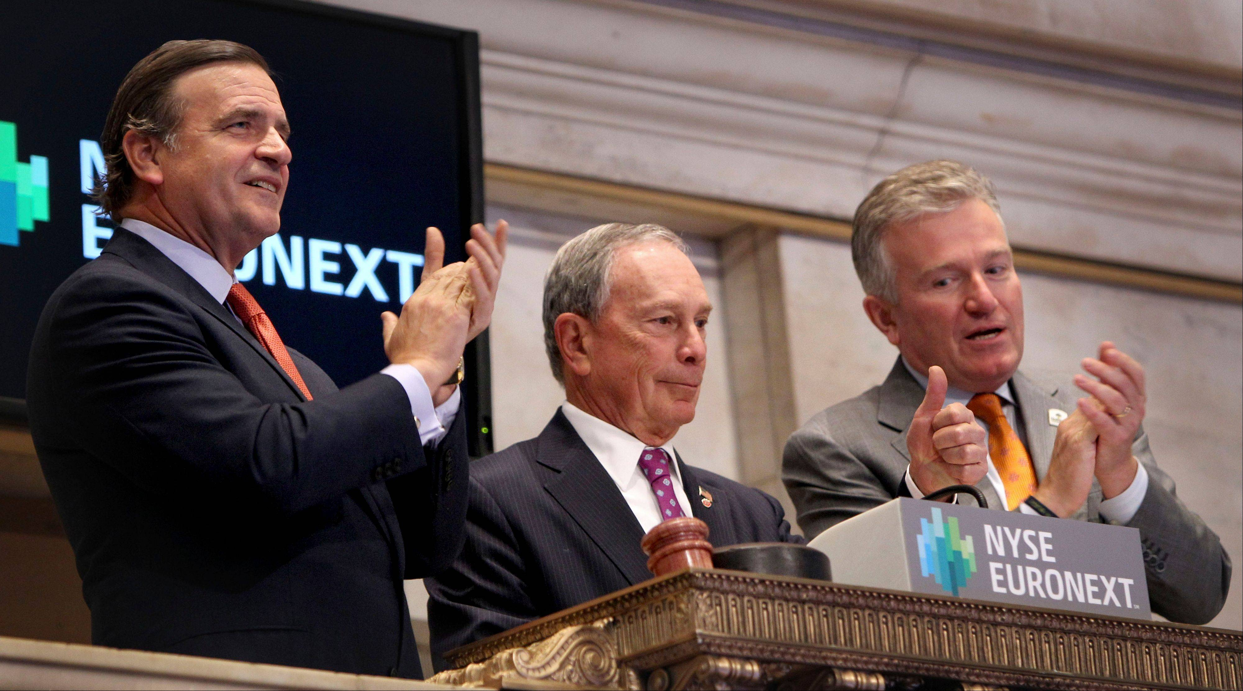 New York City Mayor Michael Bloomberg, center, gives a thumbs up after ringing in the opening bell at the New York Stock Exchange Wednesday.