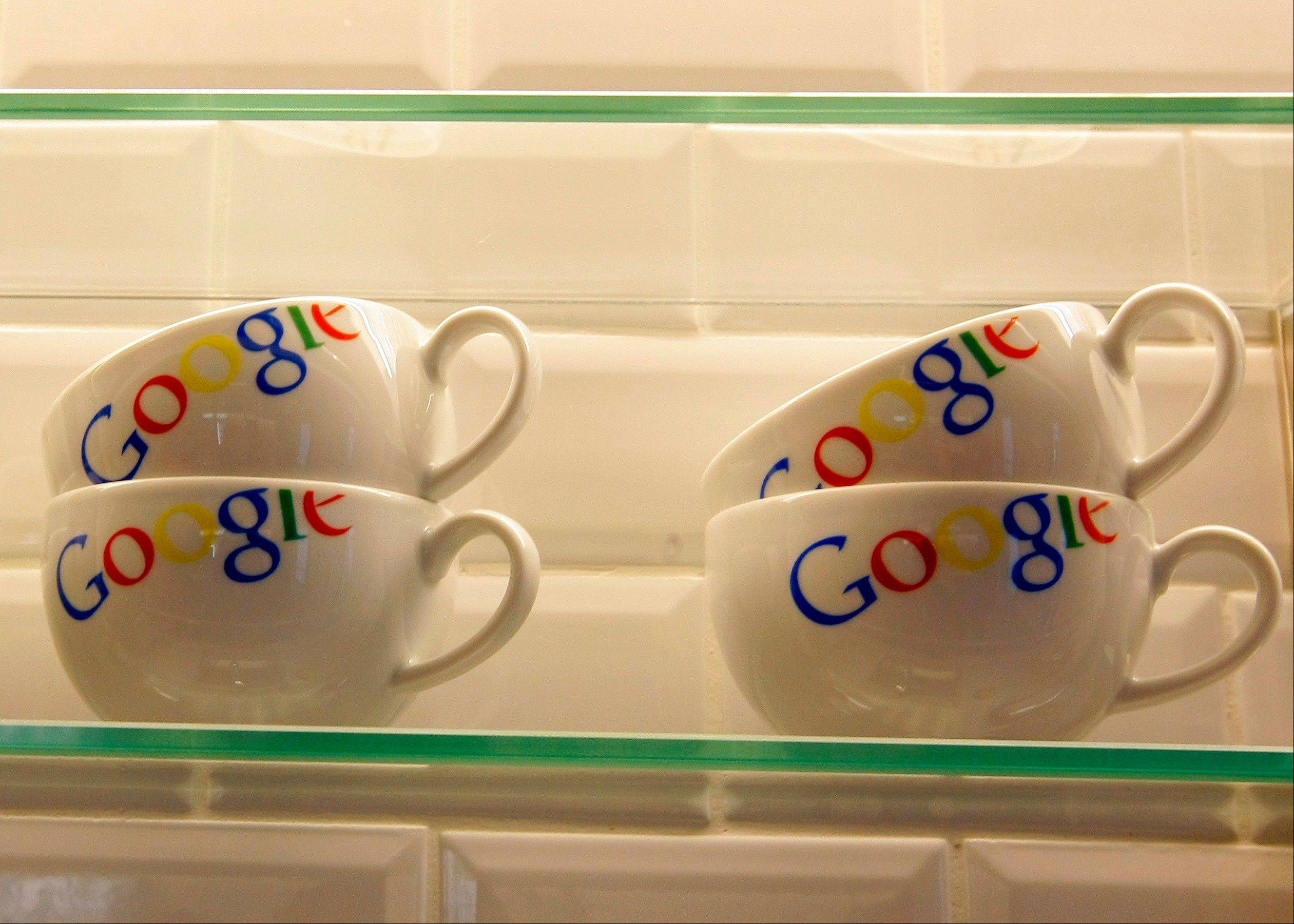 "Cups bearing the Google logo are displayed at Google France offices. Publishers in France, Germany and Italy want their governments to impose a ""news tax"" on Google to save them from extinction, demanding a law that would charge the search engine small payments in exchange for links to stories."