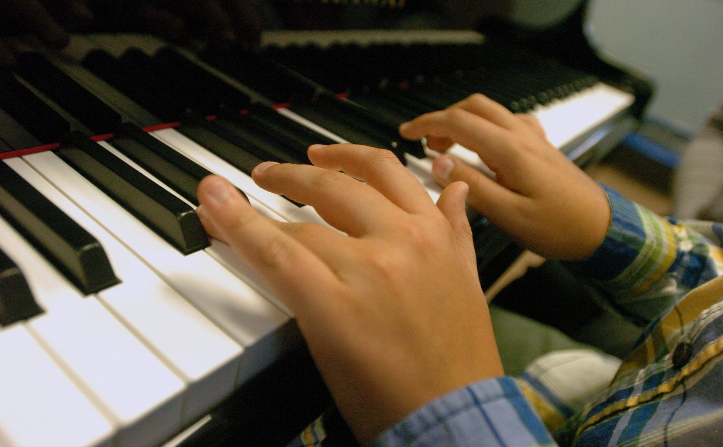 Jackson Finken's hands work the keyboard during a lesson with Beethoven's Buddies at Wheaton College.