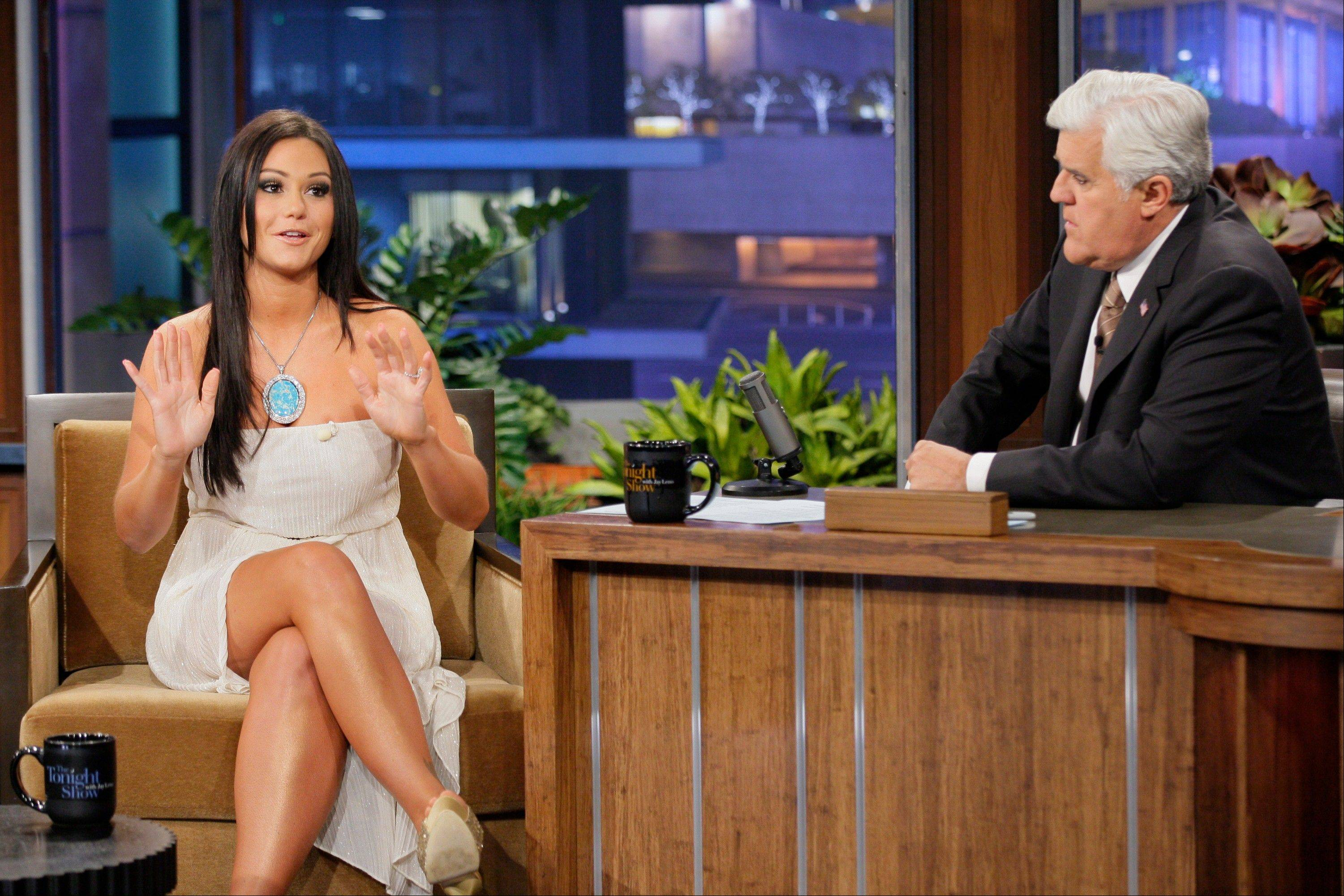 "Jenni ""JWoww"" Farley, a cast member in the reality series ""Jersey Shore,"" left, appeared with host Jay Leno on ""The Tonight Show with Jay Leno,"" Tuesday and talked about the damage done to Seaside Heights, N.J., which was hit hard by Superstorm Sandy."
