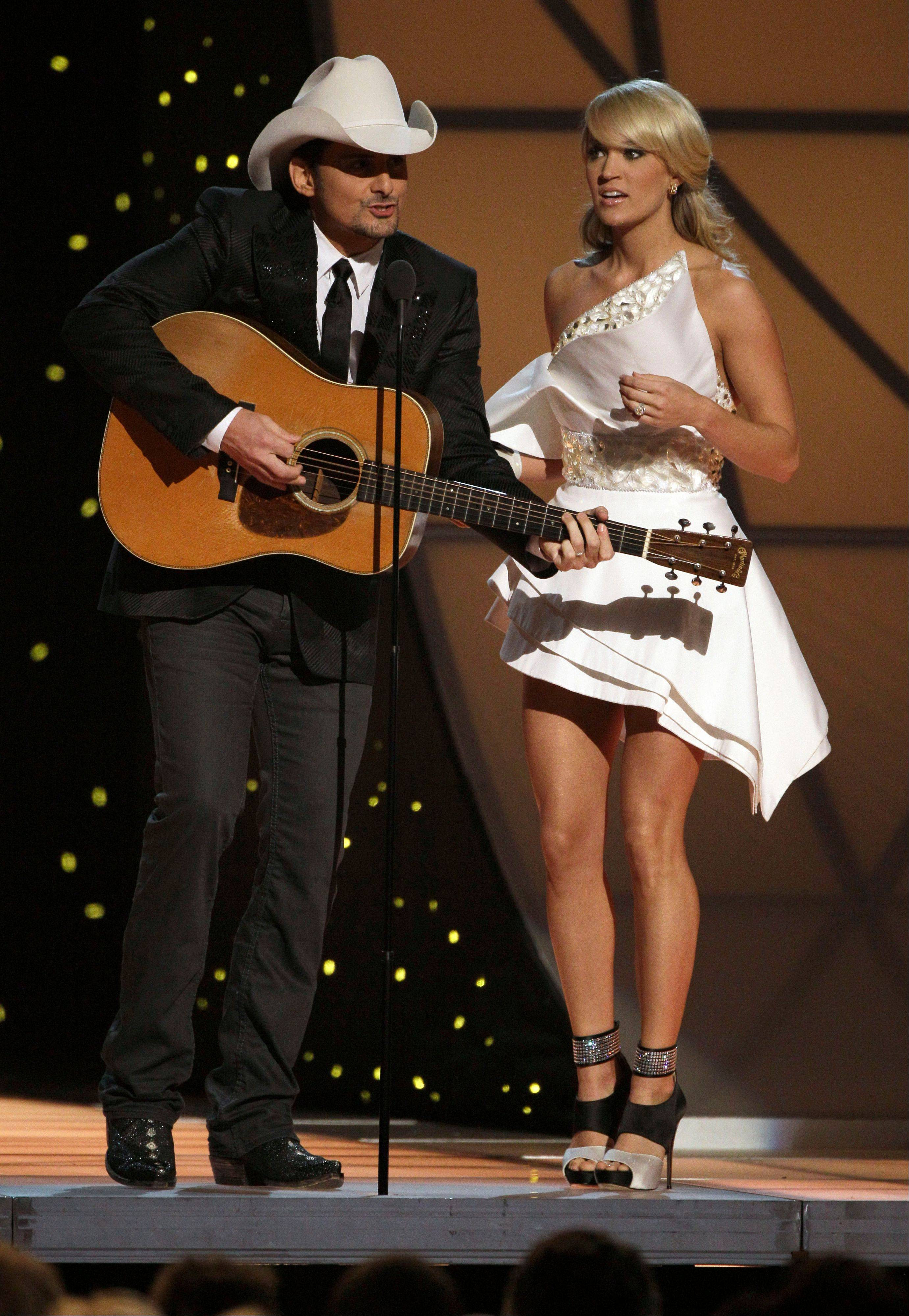 Brad Paisley, left, and Carrie Underwood will host their fifth Country Music Association Awards show in Nashville, Tenn.