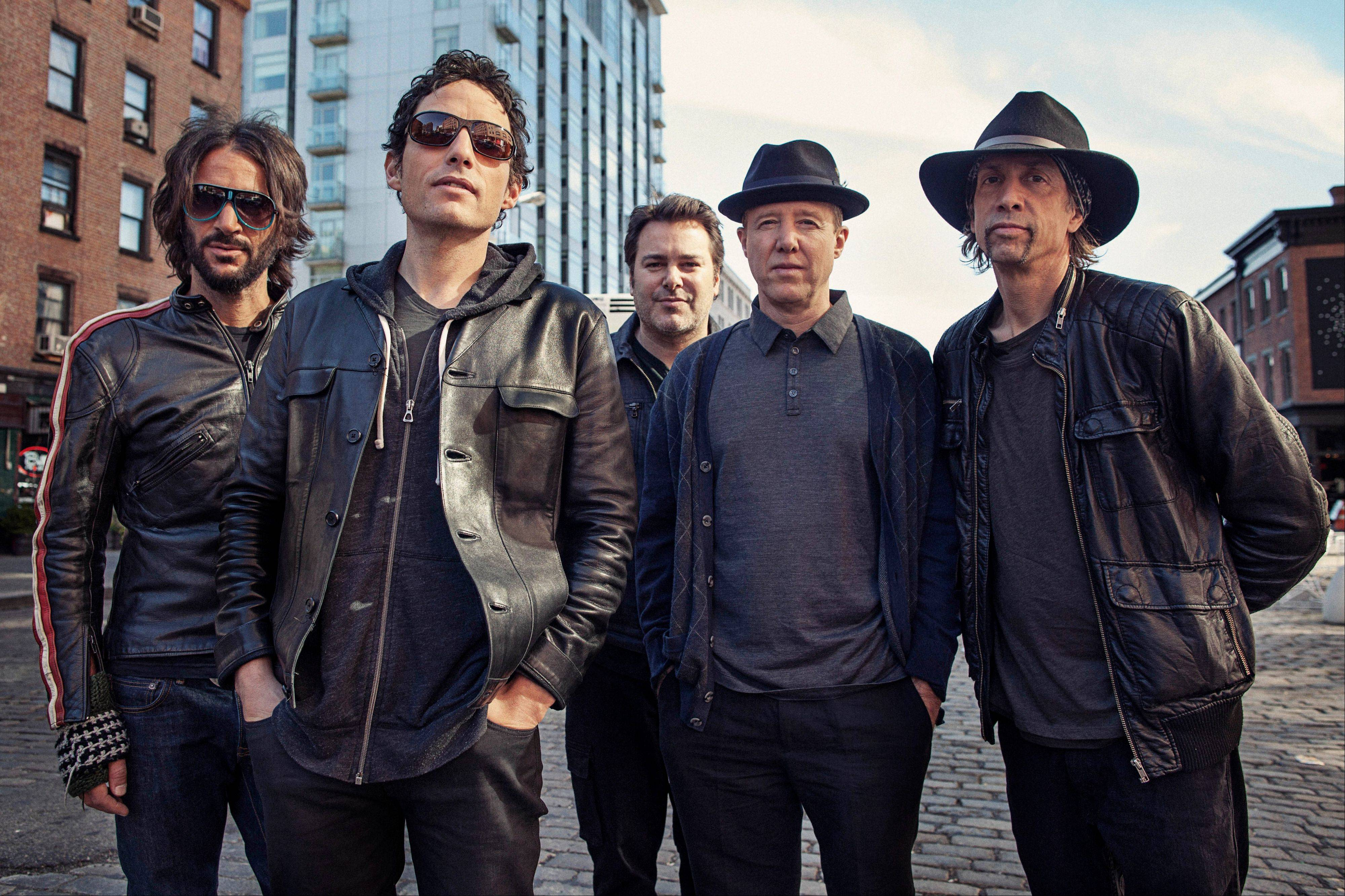 "The Wallflowers -- Rami Jaffee, left, Jakob Dylan, Greg Richling, Jack Irons and Stuart Mathis perform at the Park West Friday. a new album this month titled, ""Glad All Over."" (Photo by Victoria Will/Invision/AP Images)"