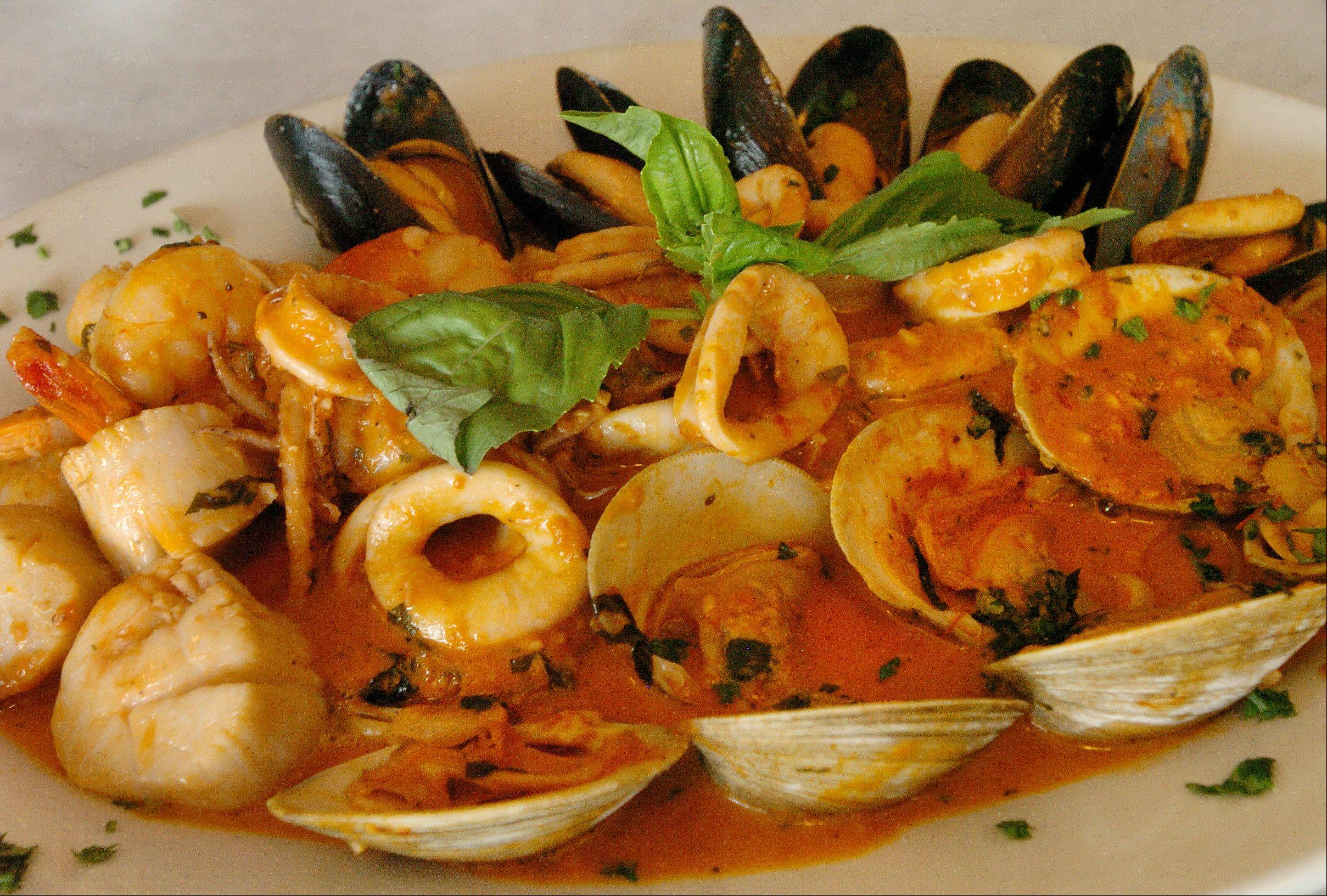 Italian seafood preparations, like this Linguine Pescatora, are abundant at DiBenedetto Trattoria in Hoffman Estates.
