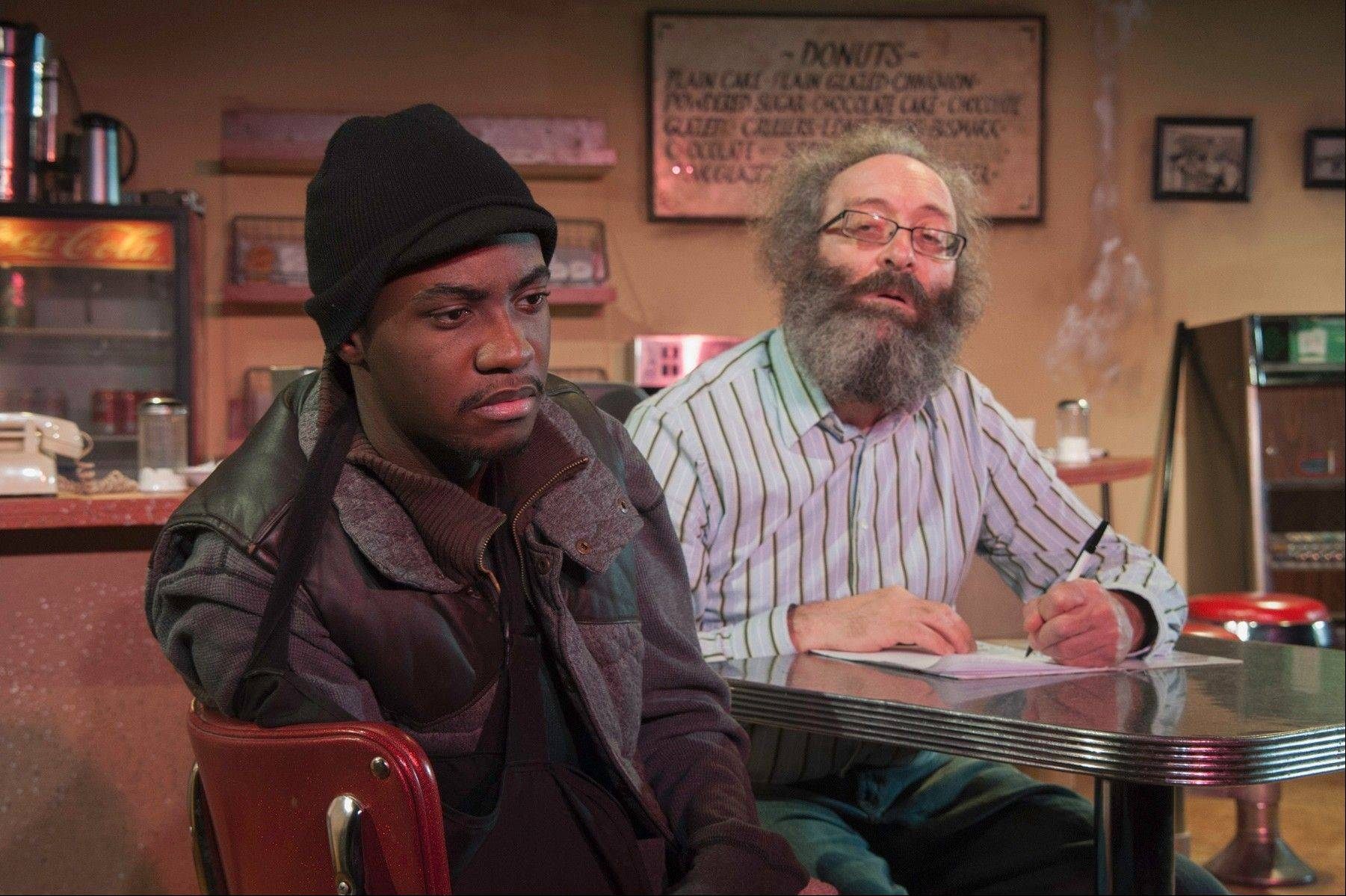 "An aspiring writer (Preston Tate Jr.) changes the life of a doughnut shop owner (Richard Cotovsky) in Mary-Arrchie Theatre Co.'s production of Tracy Letts' ""Superior Donuts,"" directed by Matt Miller."