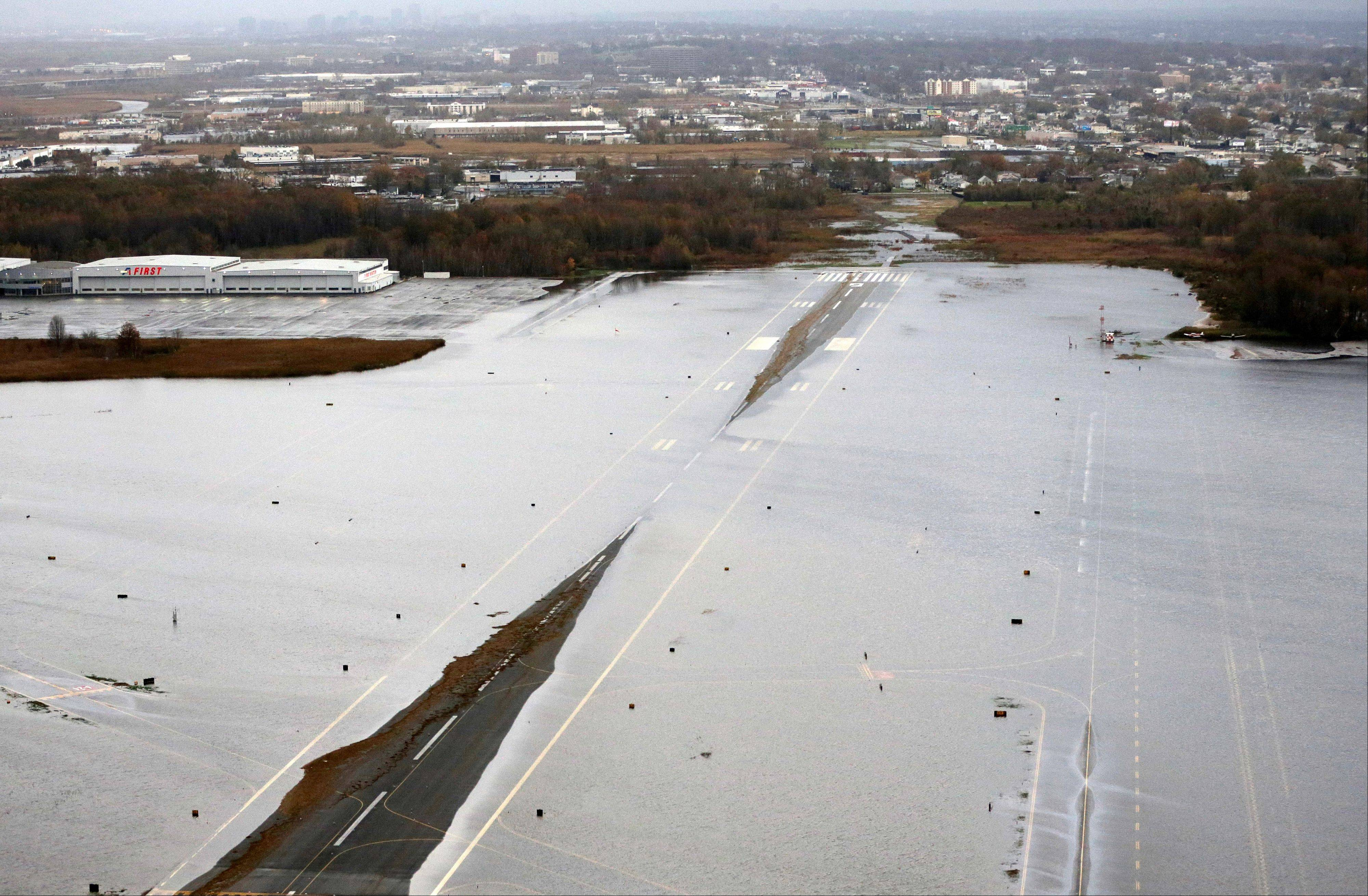 A runway at the Teterboro Airport is flooded in the wake of superstorm Sandy on Tuesday in New Jersey.