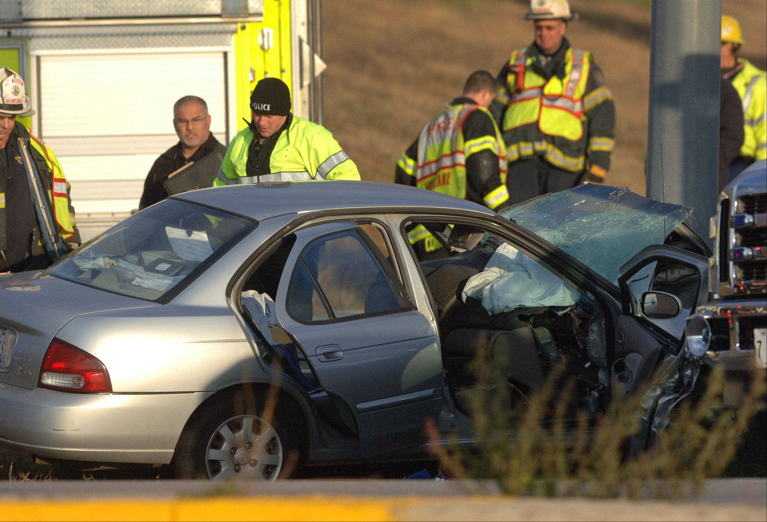 Police officials investigate the crash at Route 12 and Hartigan Road in Fox Lake early Wednesday evening.