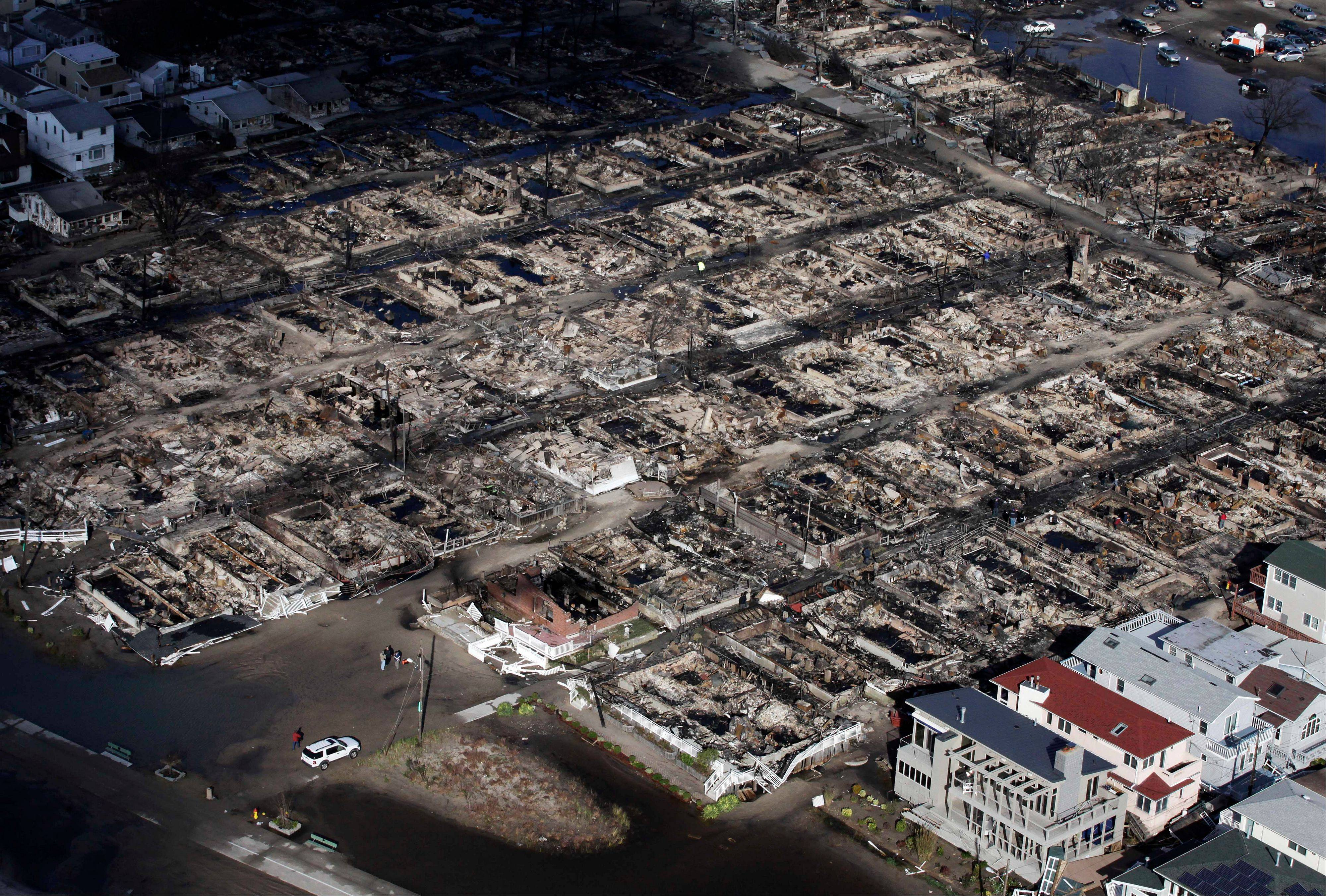 This aerial photo shows the Breezy Point neighborhood, in New York, Wednesday, Oct. 31, 2012, where more than 50 homes were burned to the ground Monday night as a result of superstorm Sandy. Sandy, the storm that made landfall Monday, caused multiple fatalities, halted mass transit and cut power to more than 6 million homes and businesses.