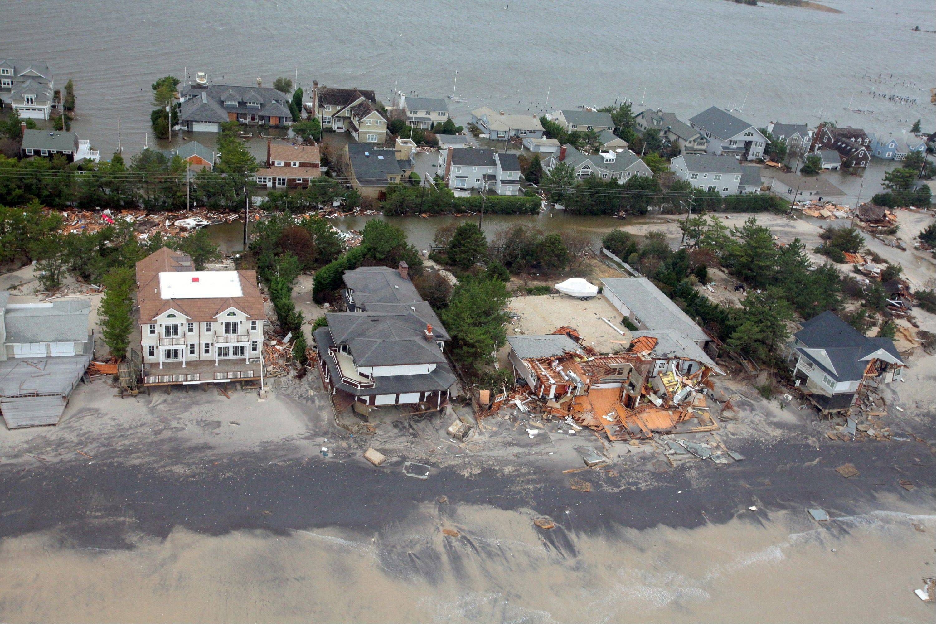 This Oct. 30, 2012 aerial photo provided by the U.S. Air Force shows damage to the New Jersey shoreline during a search and rescue mission by 1-150 Assault Helicopter Battalion, New Jersey Army National Guard. By late Tuesday, the winds and flooding inflicted by the fast-weakening superstorm Sandy had subsided, leaving at least 55 people dead along the Atlantic Coast and splintering beachfront homes and boardwalks from the mid-Atlantic states to southern New England.