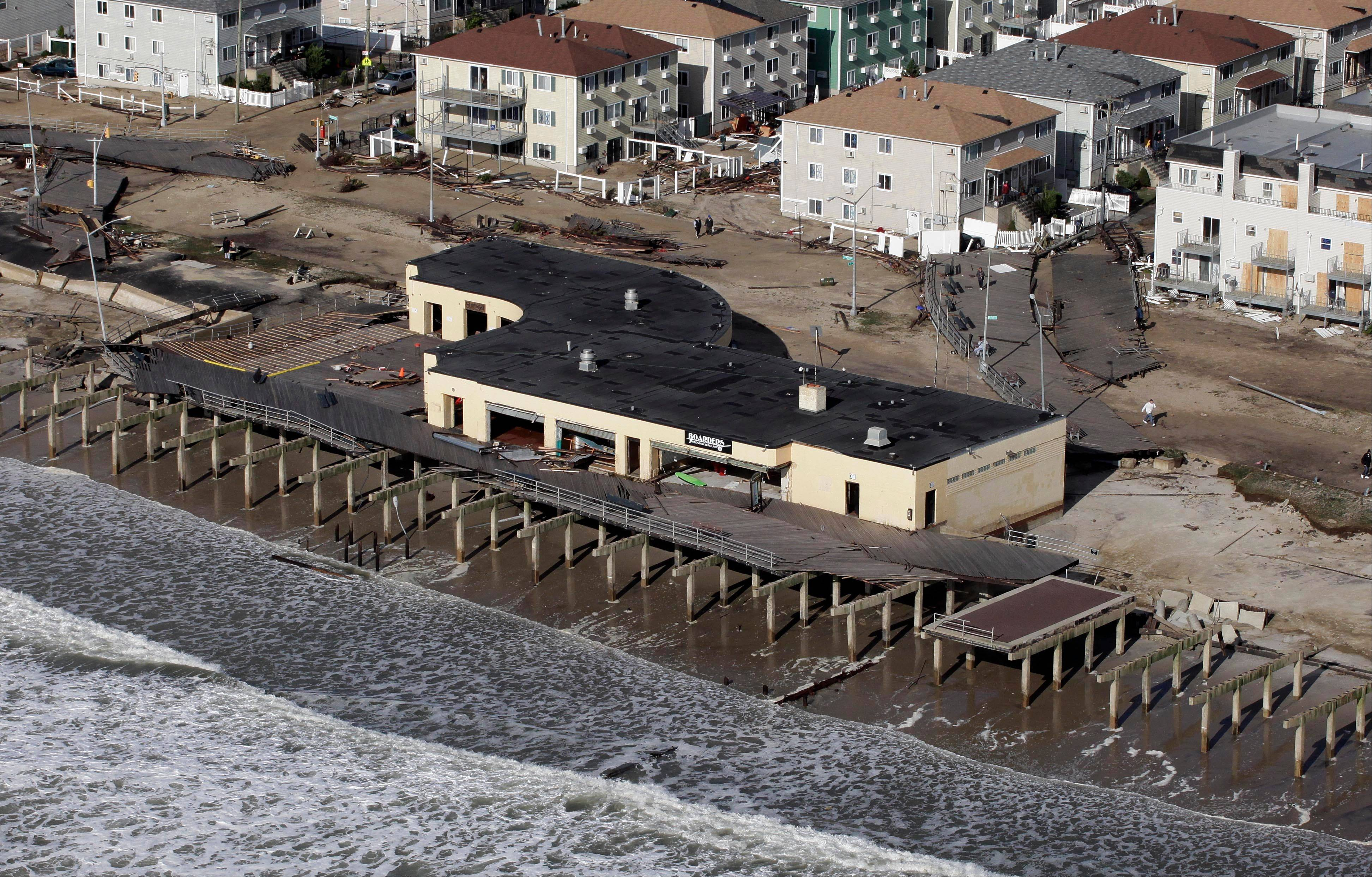 The boardwalk at Rockaway Beach is largely destroyed, Wednesday, Oct. 31, 2012, following superstorm Sandy which struck New York Monday and Tuesday. Sandy, the storm that made landfall Monday, caused multiple fatalities, halted mass transit and cut power to more than 6 million homes and businesses.